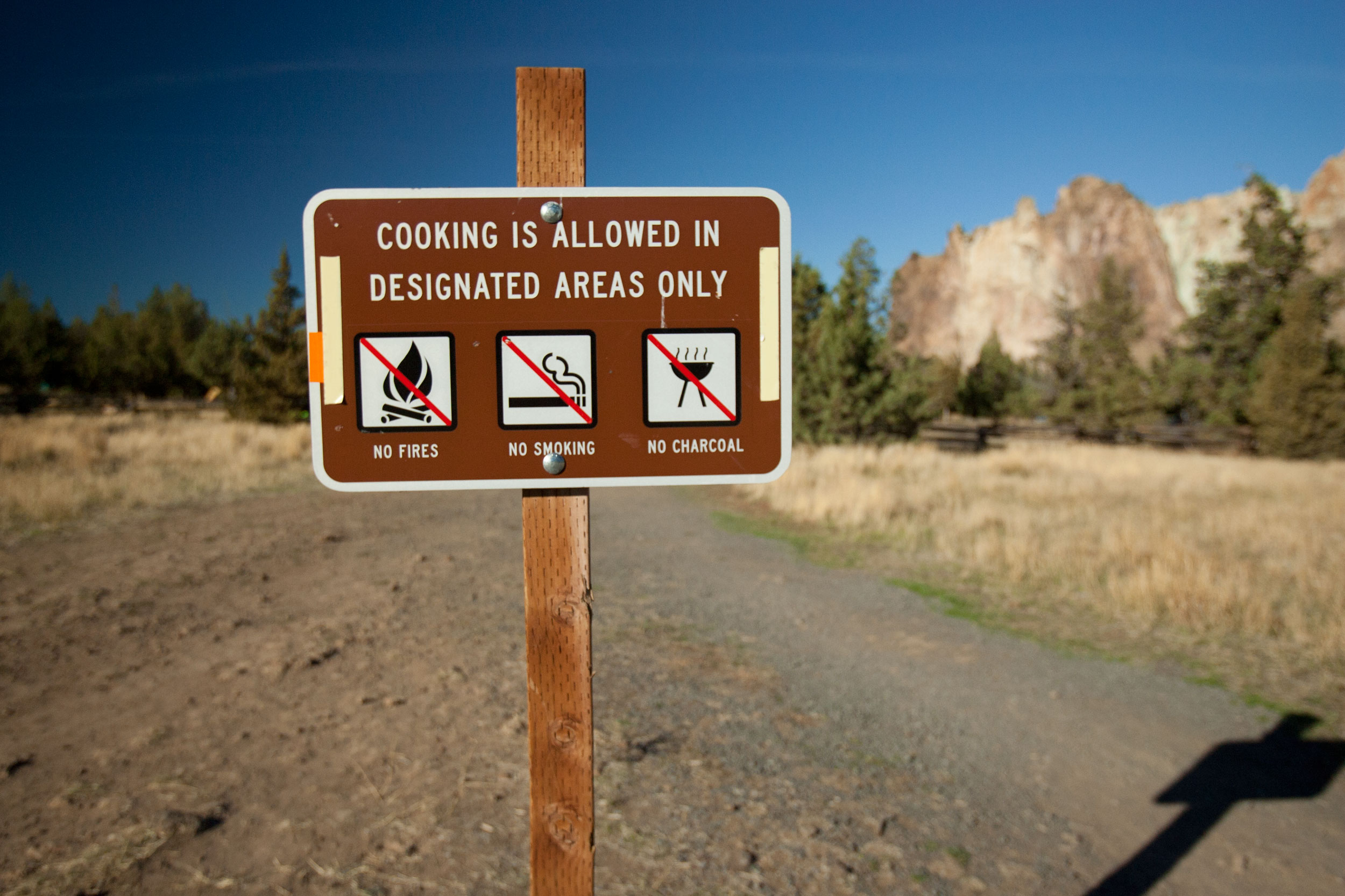 cooking in designated area and no fires or smoking sign at the Bivy campground at Smith Rock State Park