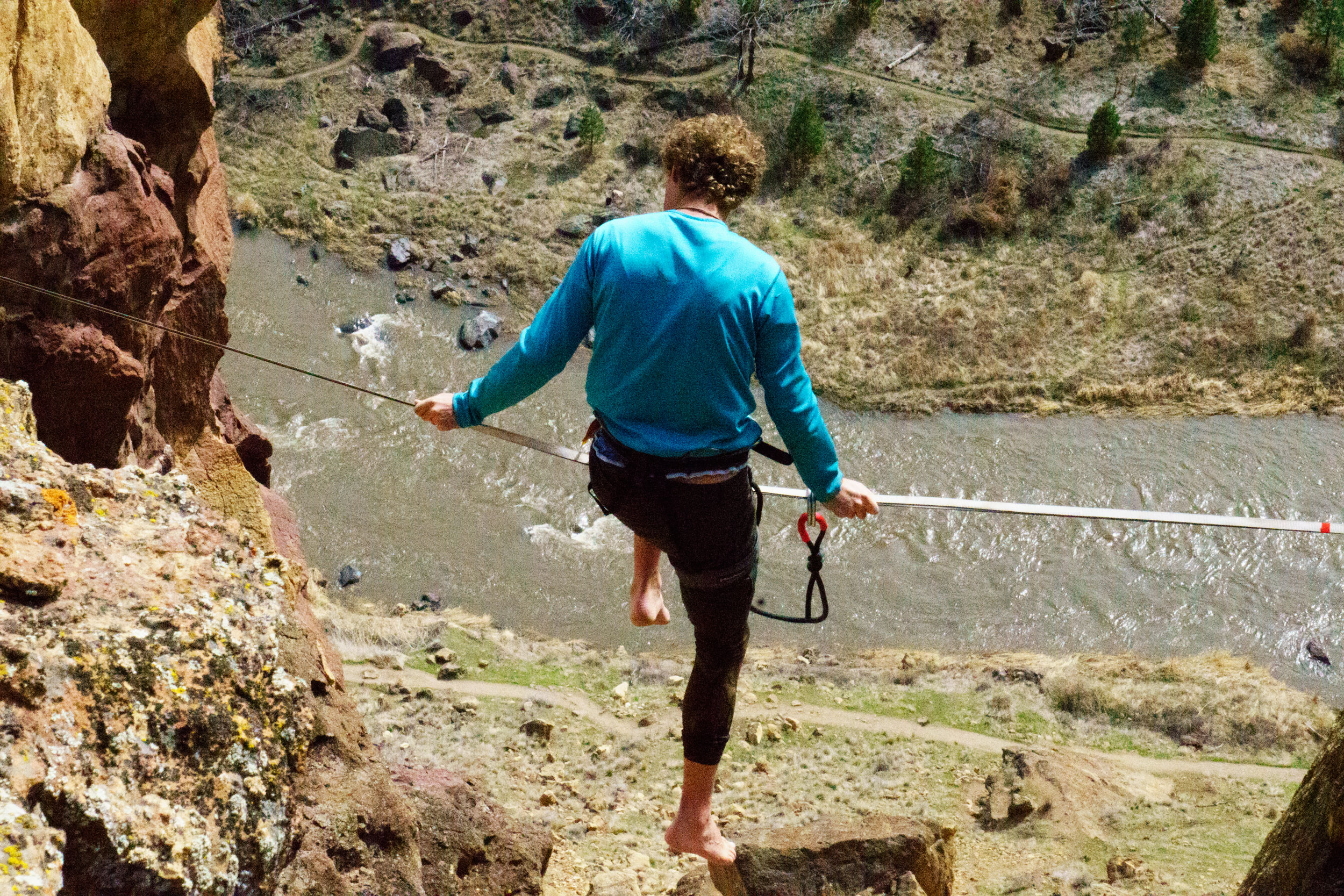 slackliner resting on  Dog Fight highline  at Smith Rock State Park