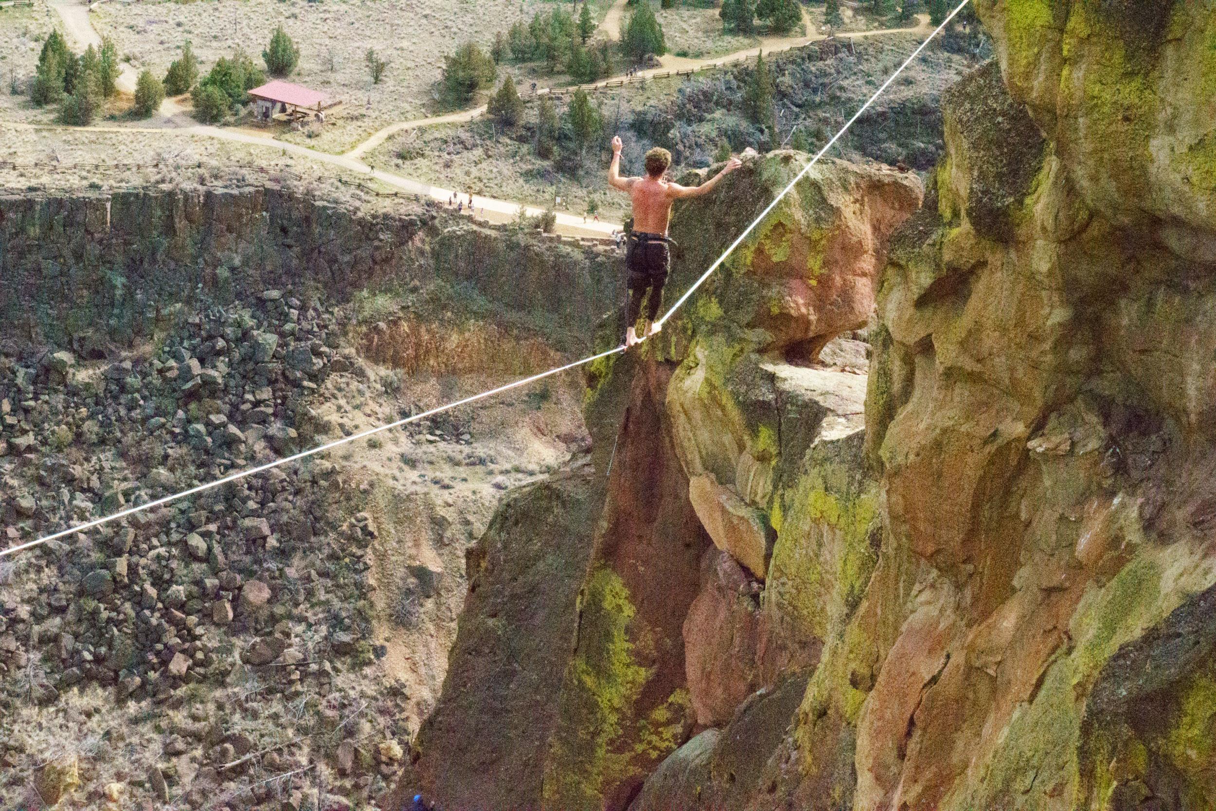 slackliner on Free Your Mind highline at Smith Rock State Park