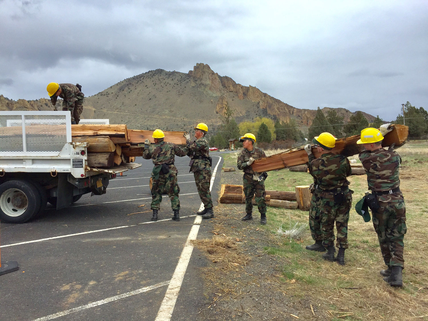 Oregon Youth Challenge cadets load truck of split telephone poles at Smith Rock State Park