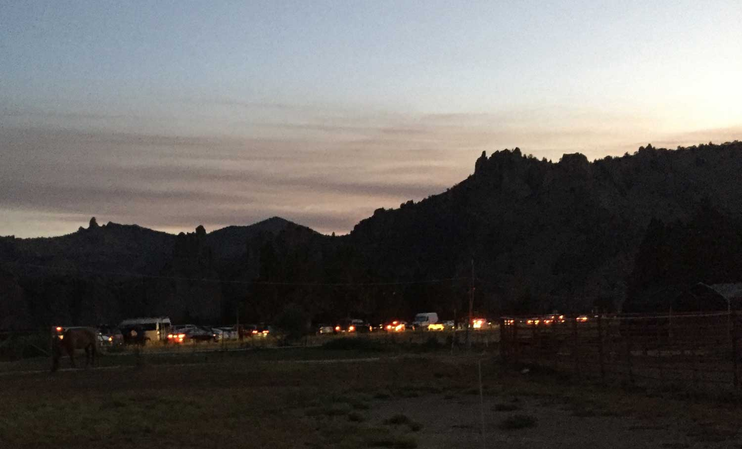 Traffic streaming in at 5:30 AM as the makeshift gate opens for the Total Solar Eclipse at Smith Rock