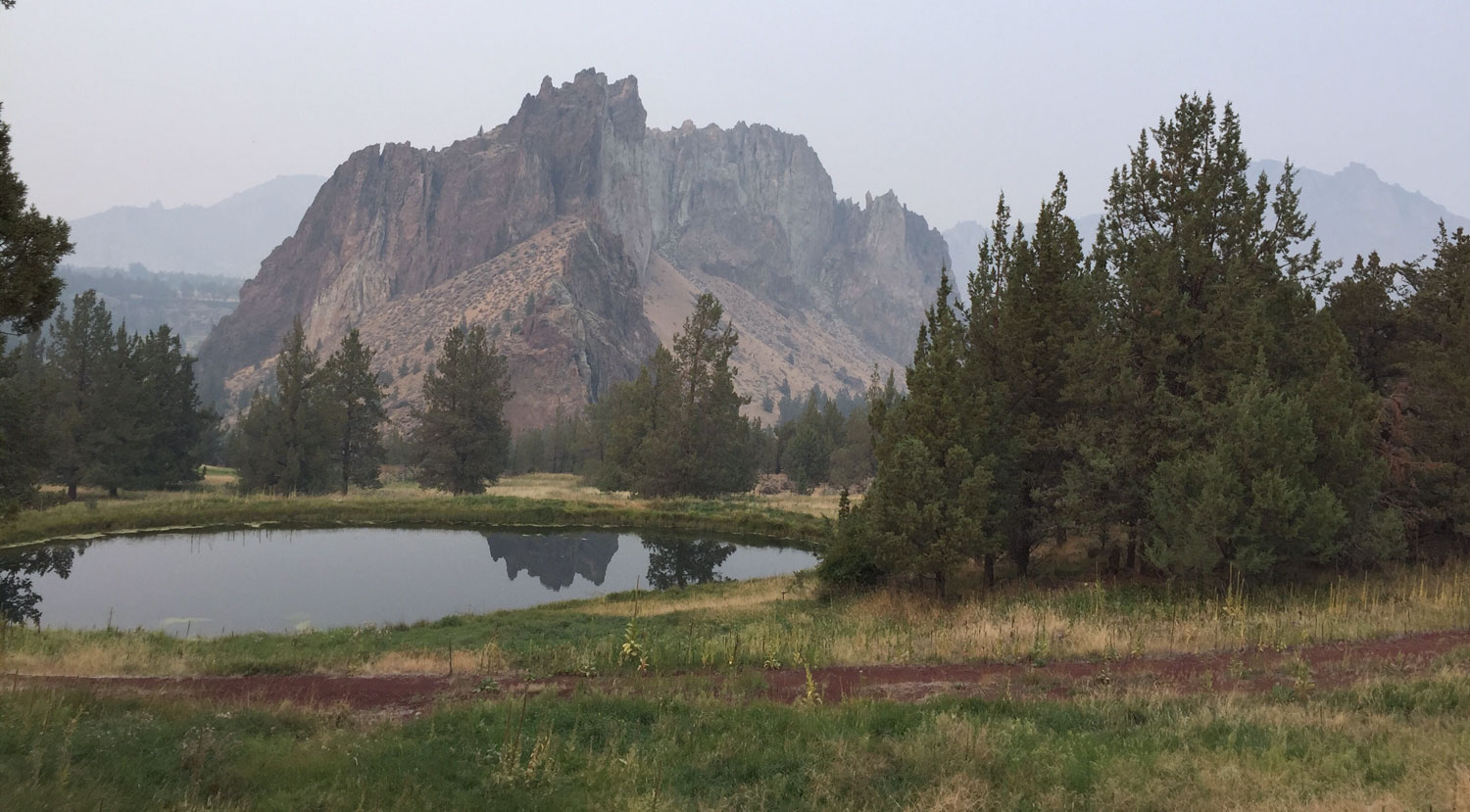 Normal crisp views of the park's rock spires are visible from here but obscured by haze