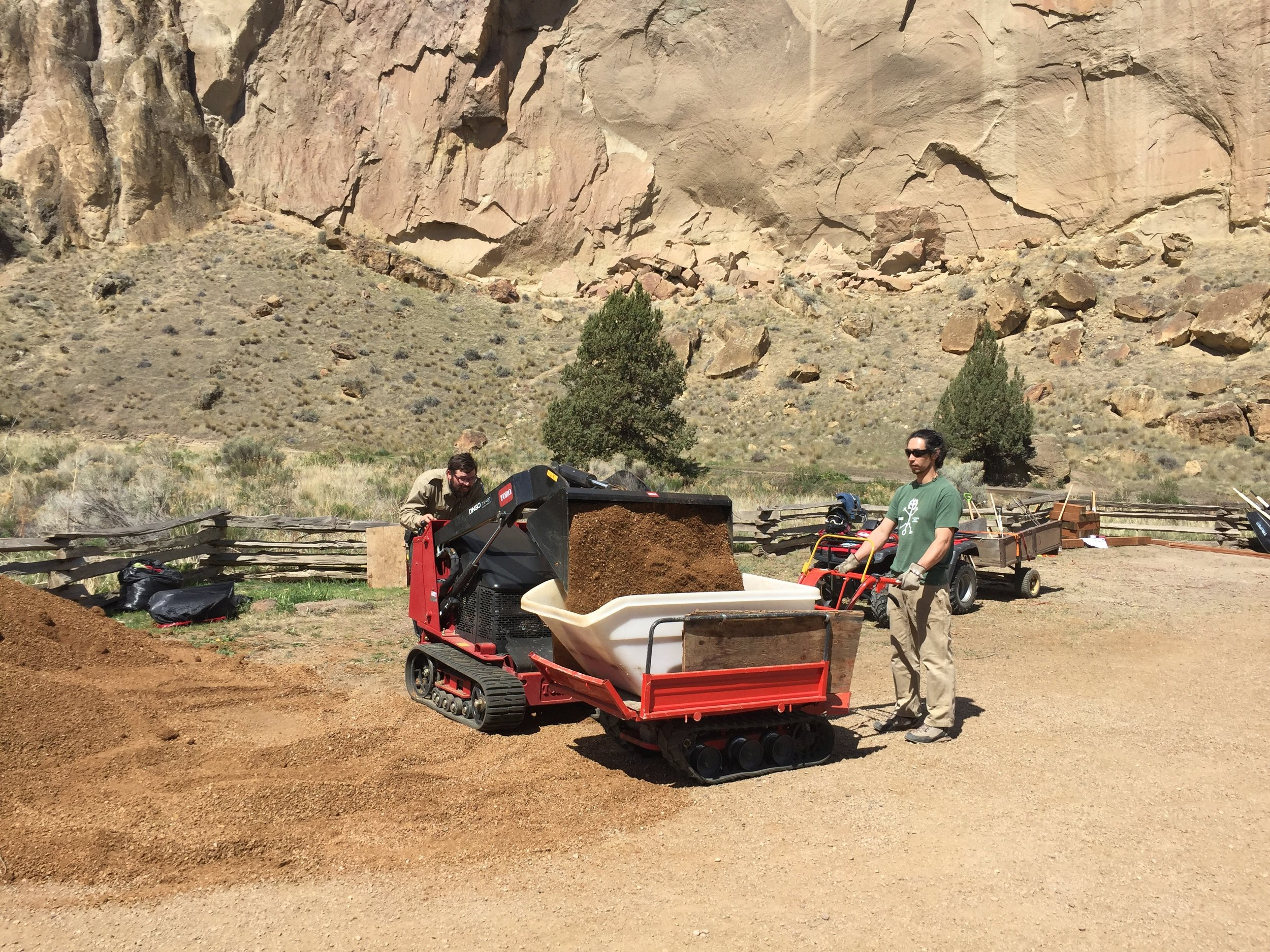 This park ranger got serious about moving dirt with one of the volunteers.