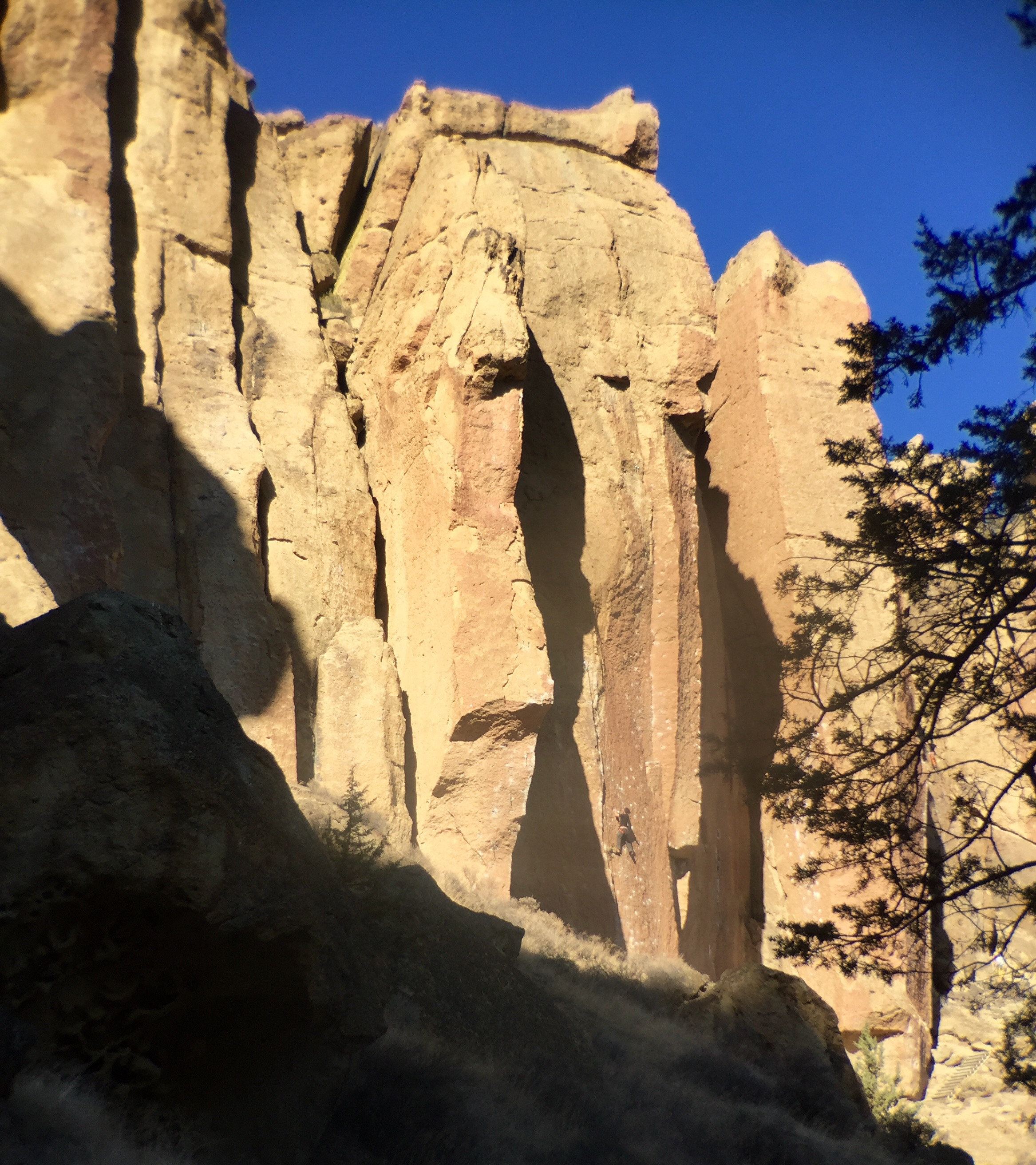 rock climber  basking in the early morning sun in  the Dihedrals  at Smith Rock State Park