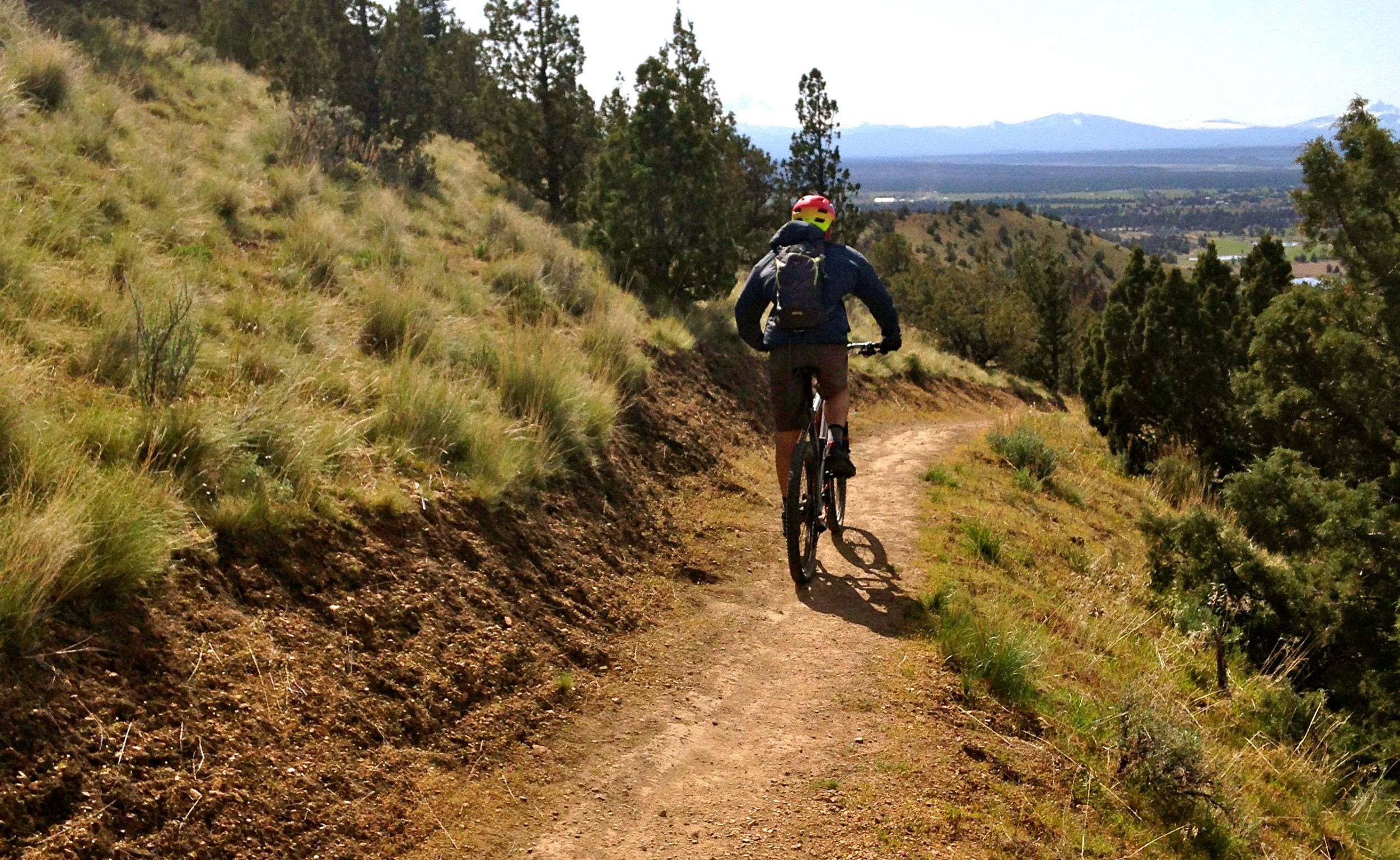 Mountain biker doing the Summit Loop Trail in reverse.