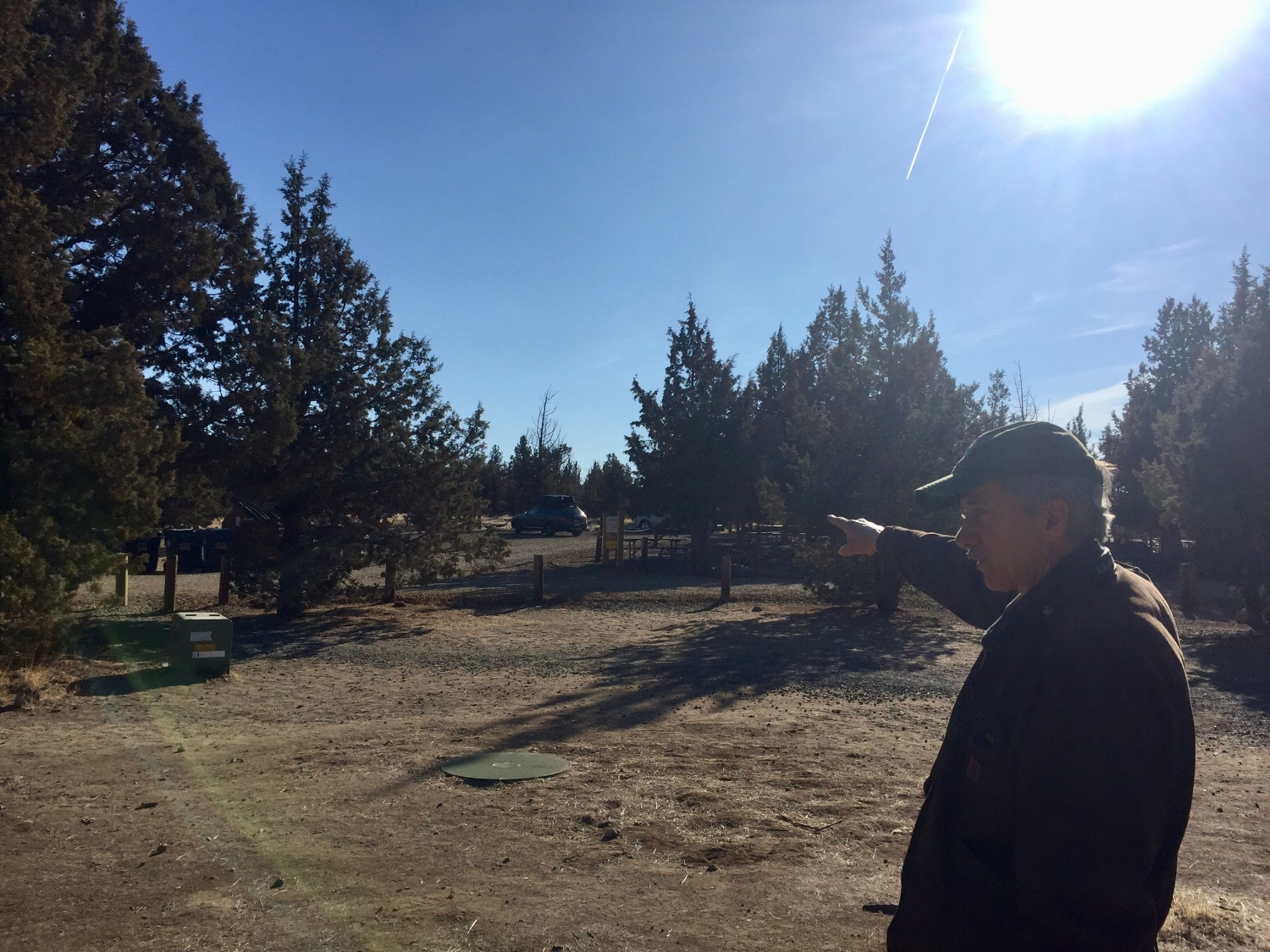 Smith Rock State Park Manager Scott Brown stands in the Bivy/Campground open area by the existing restrooms, where a shaded shelter and kitchen shelter will replace the current Common Area that will be reduced to just a few tables. Click to enlarge.