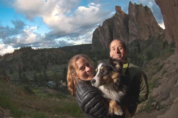 Kristin Yurdin holds Casbah, while Ian Yurdin smiles contently in their happy place at Smith Rock. Image courtesy of Andy Mann.