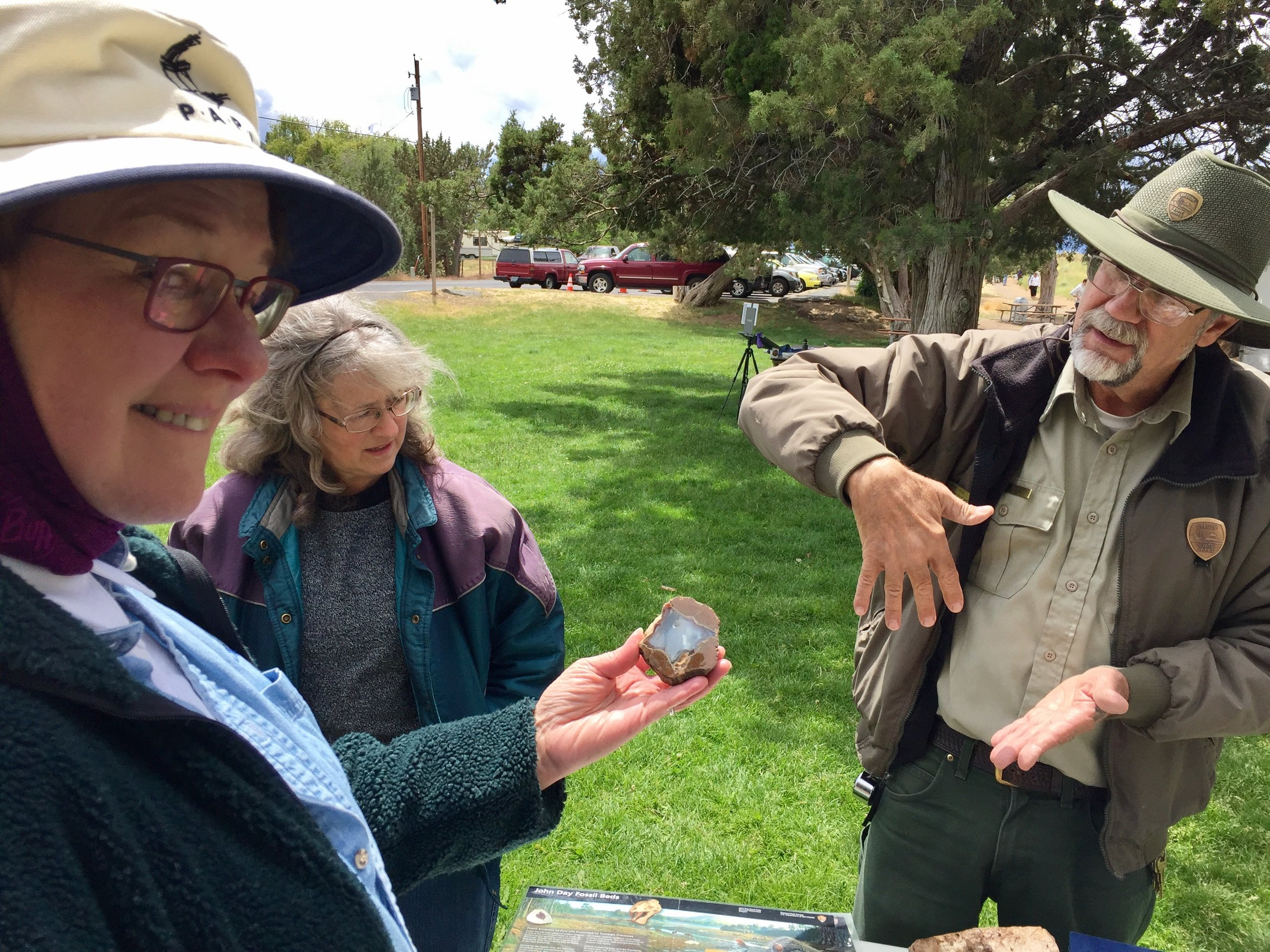 Former Smith Rock State Park Naturalist David Vick talks geology with a couple of painters here to enjoy the annual Smith Rock Paint Out.