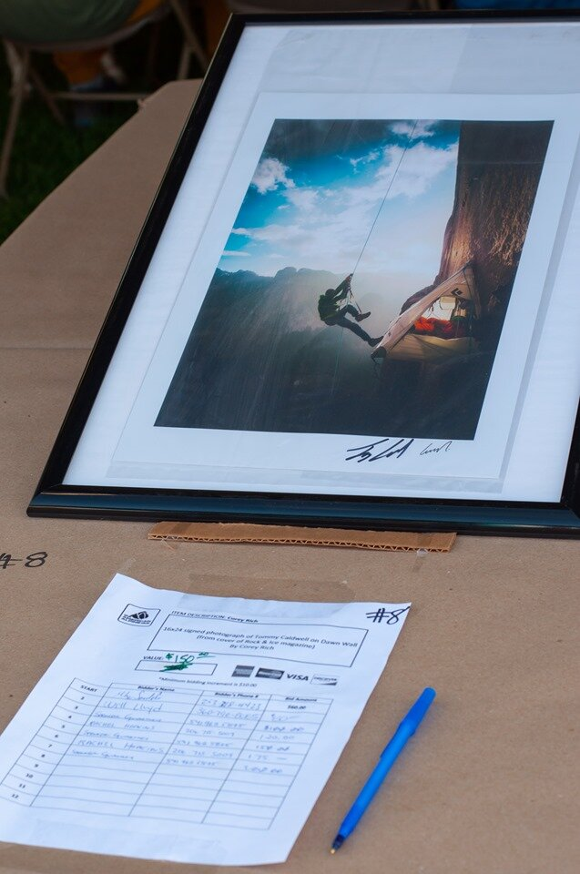 Corey Rich photo of Tommy Caldwell and Kevin Jorgeson on the Dawn Wall at the silent auction.  Photo by Janelle Dransfield.