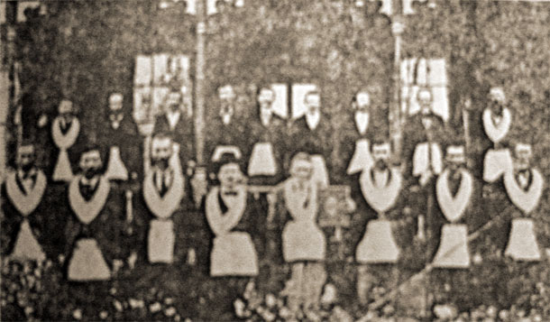 This picture of Inman 201 A.F.M. Lodge members was take circa 1900 in front of the the Inman Hotel. Reading from left to right, front row: Gabe Foster, Mr. McElrath, Ed Finch, Enoch Lawrence, Simeon Gowan, Jim Pope, Hill Humphrey, (Grandpa) Humphrey. Back row: Lee Moore, Wreck King, Jim Brock, Tom Brock, Jackson Stone, E.I. Bishop (Mayor of Inman), Dr. J.R. Gibson, Mathew L. Bishop, Adam Ballenger.