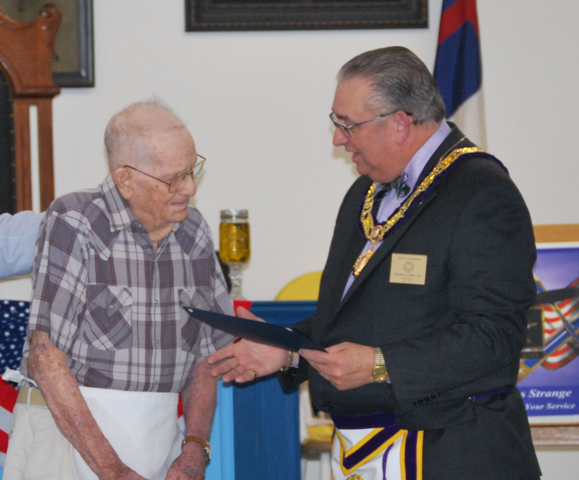 Brother Jay Strange receives his Certificate of Recognition from MWB Michael D. Smith.