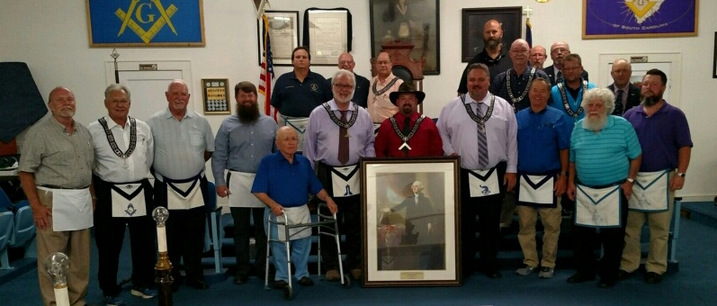 The members of Inman Masonic Lodge pose with the portrait presented by Brothers Ken and Gene Kuszmaul.