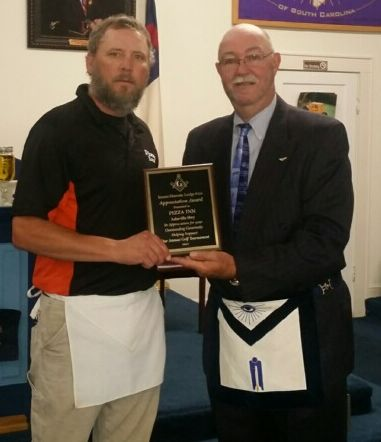 Brother Rusty Aker being presented a plaque from Inman Masonic Lodge by Brother Stephen Parris.