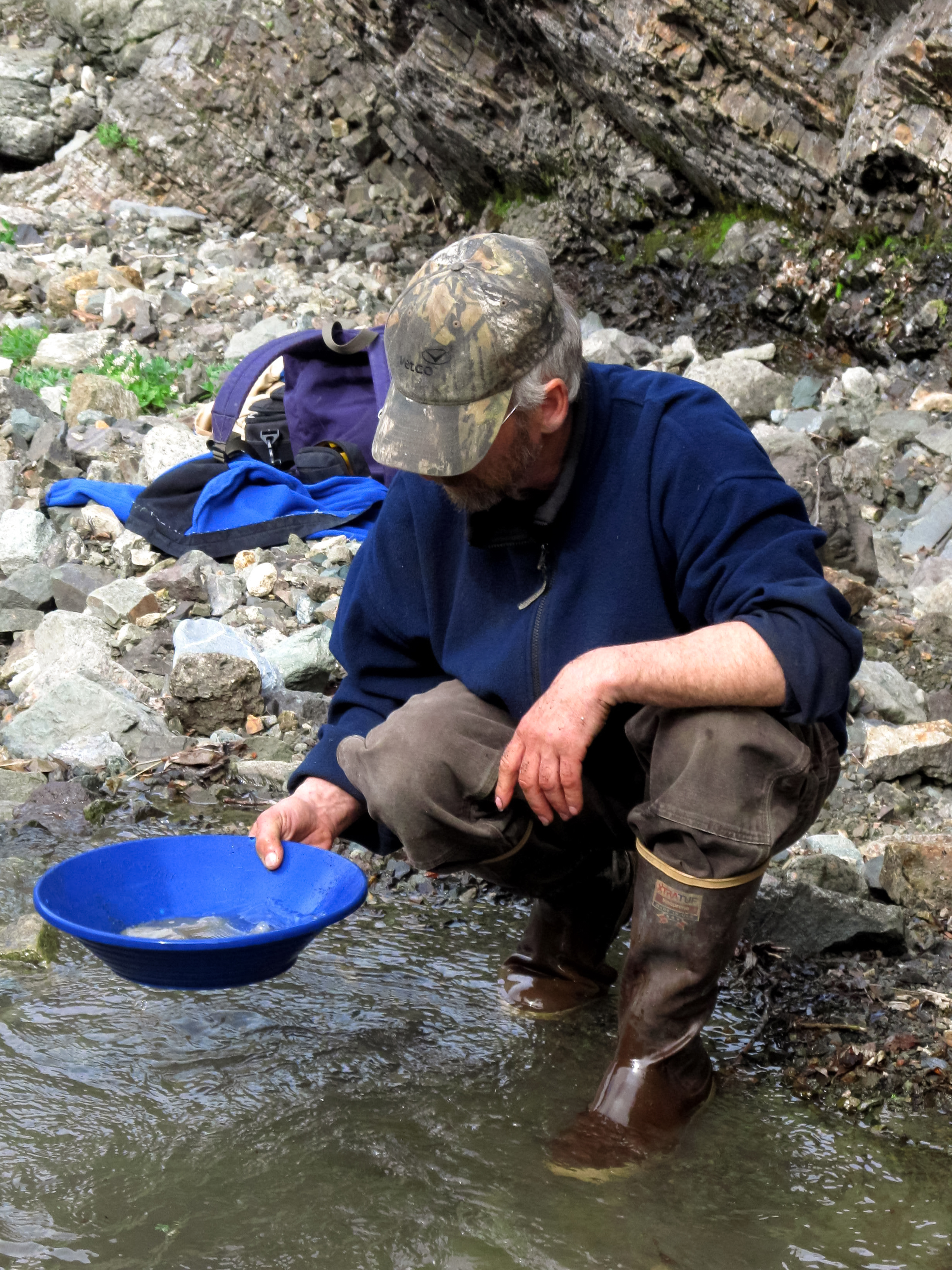 Panning for gold in the creek.