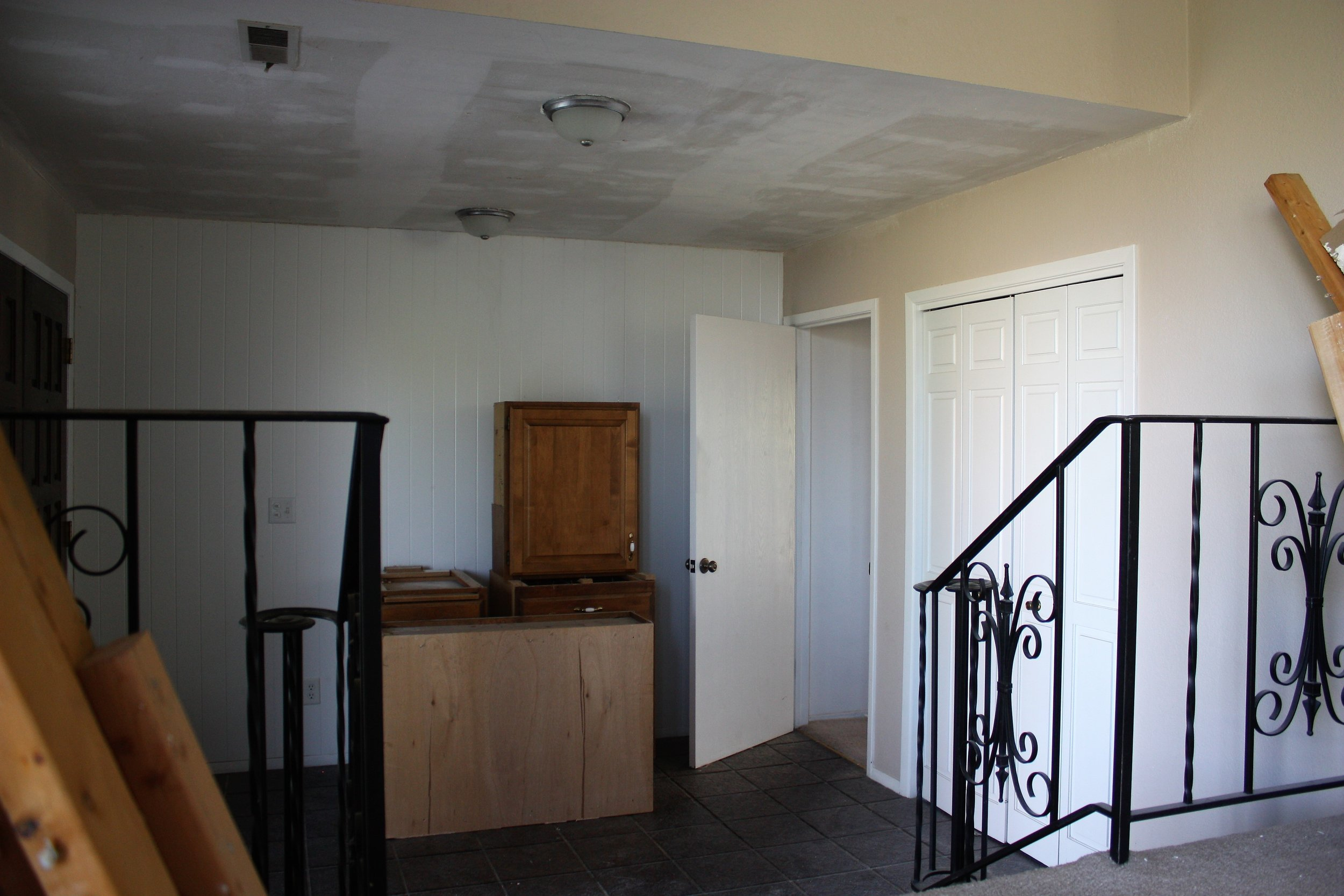And here is the view of the entryway from the living room. This is one of the spaces I am most looking forward to giving new life to.