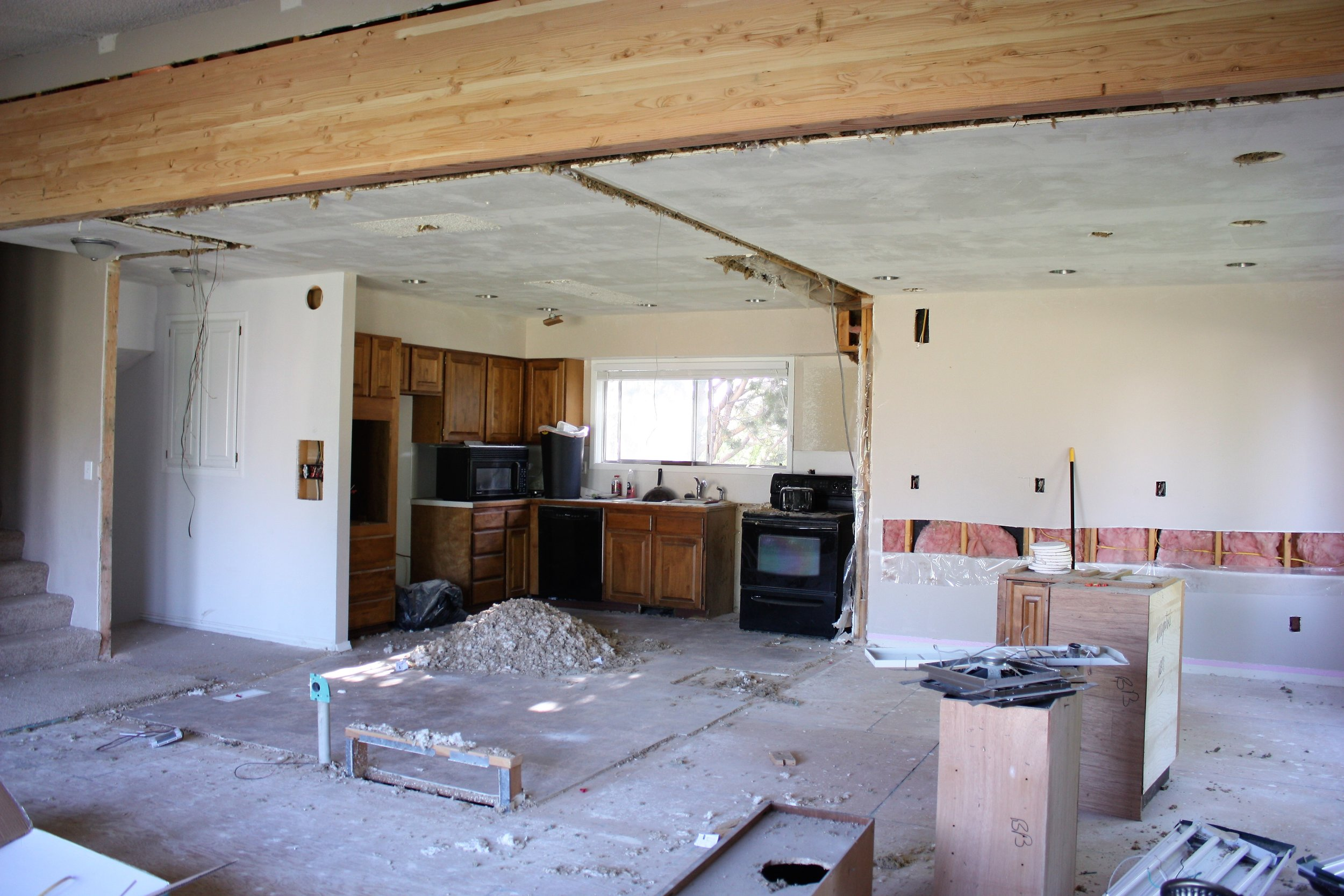 And finally, here is a view of the kitchen and dining area. You can see the electric going in and all the can lights we will soon have.