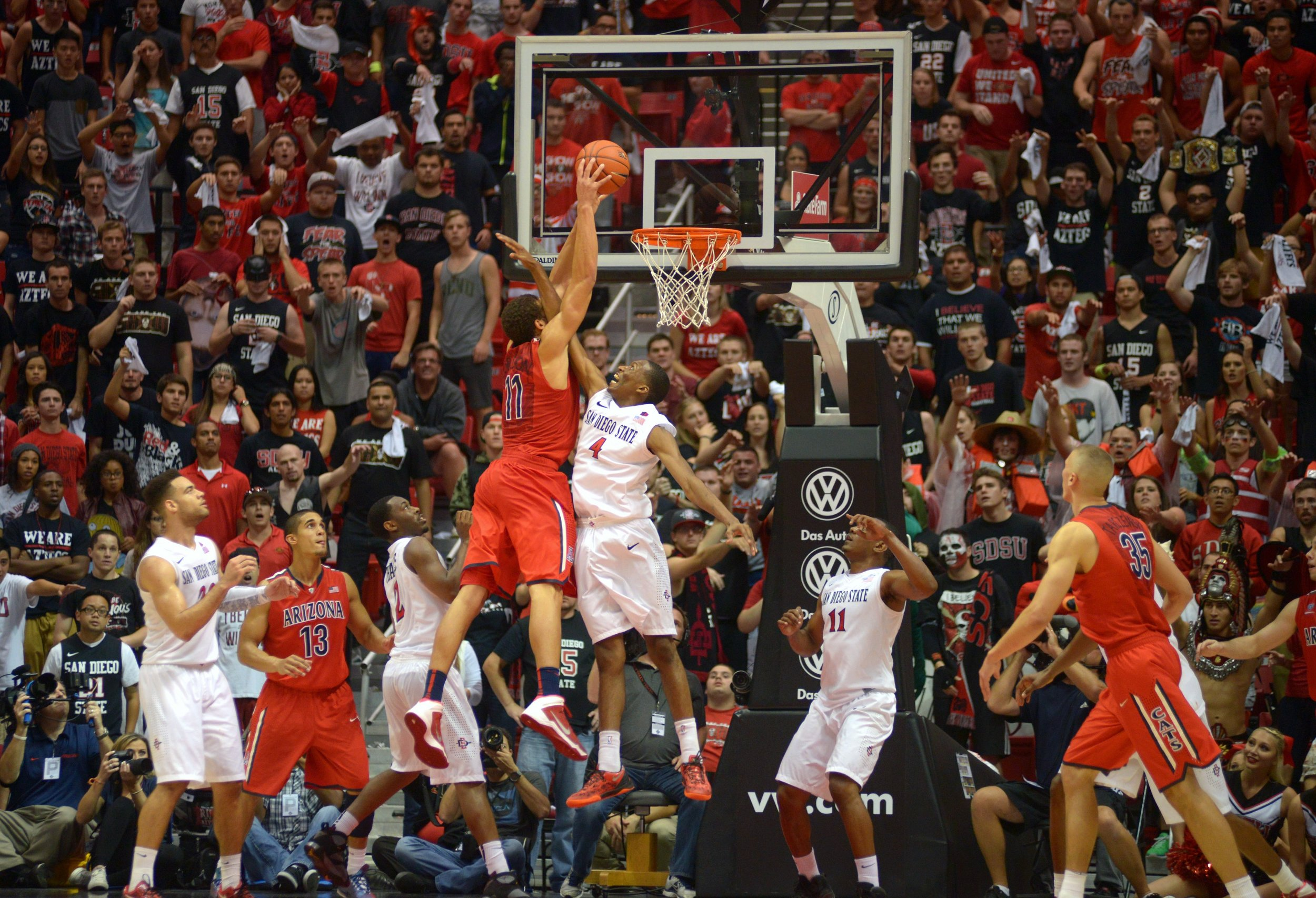 SAN DIEGO, CA - NOVEMBER 14: Aaron Gordon #11 of theArizona Wildcats dunks the ball on an inbounds pass in the second half of the game and is fouled by Dakarai Allen #4 of the San Diego State Aztecs at Viejas Arena on November 14, 2013 in San Diego, California. (Photo by Kent C. Horner/Getty Images)