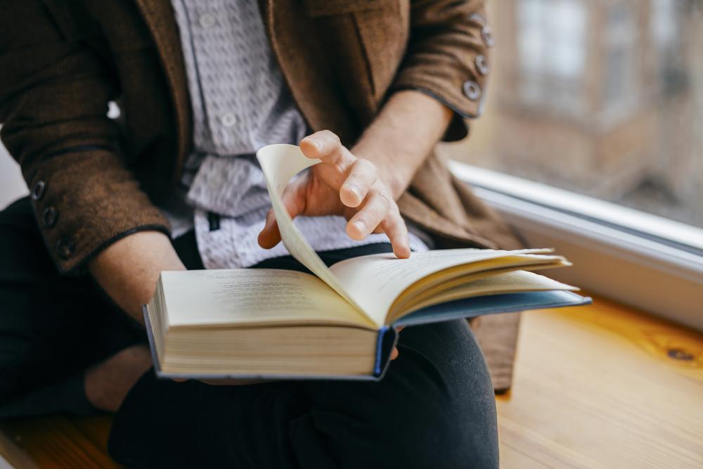 Guy reading book.jpg