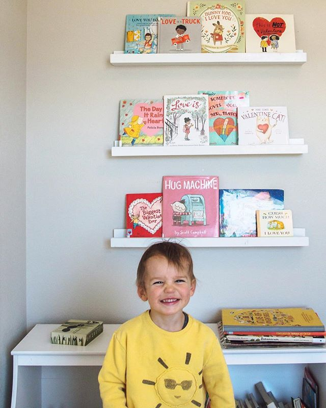 A bookshelf full of pink and red and a happy little boy. Happy Valentines Day!! 💛💛 • • • • • • #valentines #happyvalentinesday #valentinebooks #valentinekids #bookish #readingisfun #readallthebooks #readeveryday #read #library #bibliophile #bookstagramfeature #kidlit #raisingreaders #elementaryreaders #kidsbookswelove #readeveryday #kidsbooksofinstagram #kidlitfeature #earlyreaders #kidswhoread #childrensbooks  #kidlitart #picturebooks #becauseofreading #booknerd #picturebook #kidsbook #kidsbooks #readtome