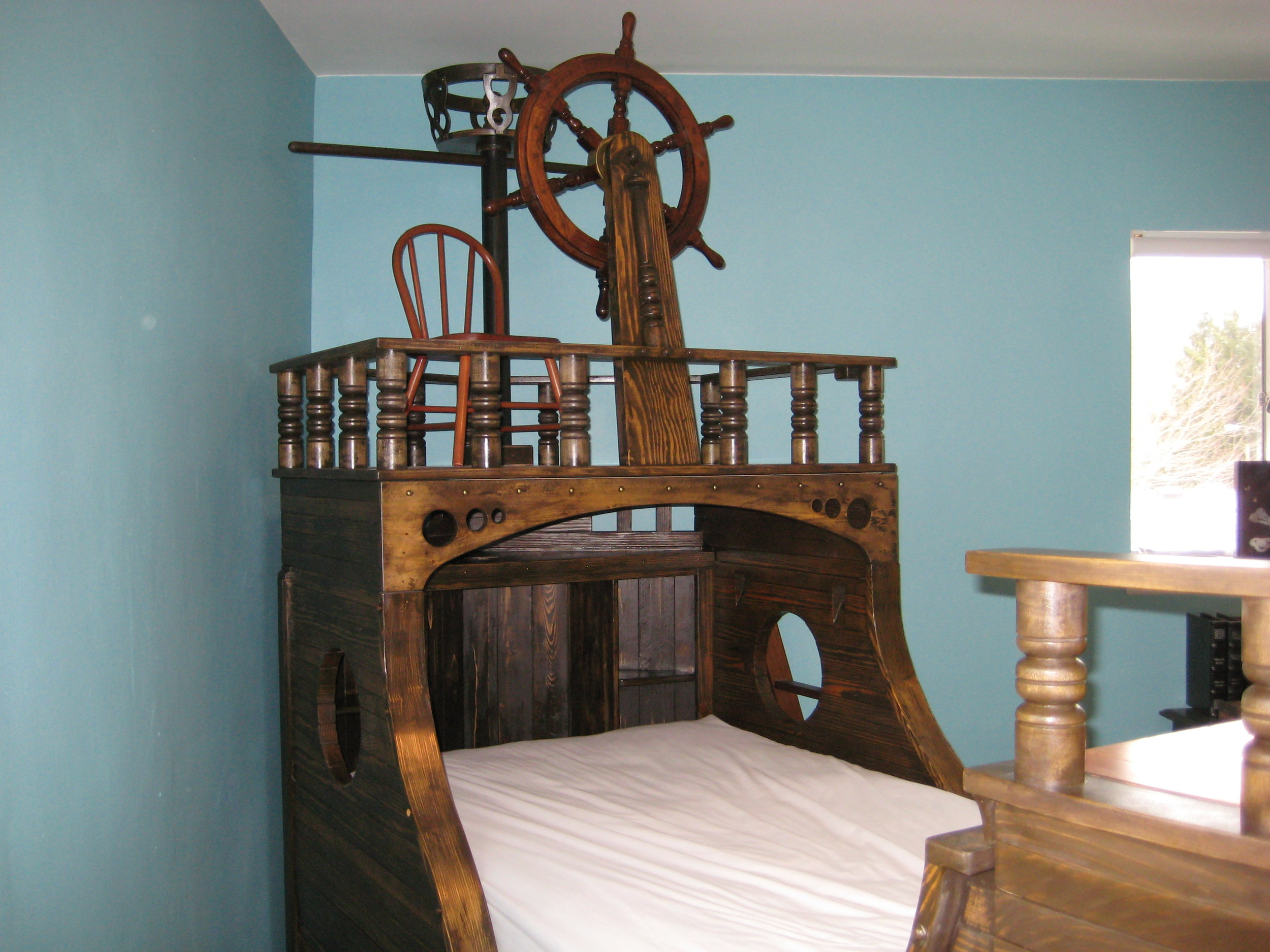A pirate ship theme child's bed.