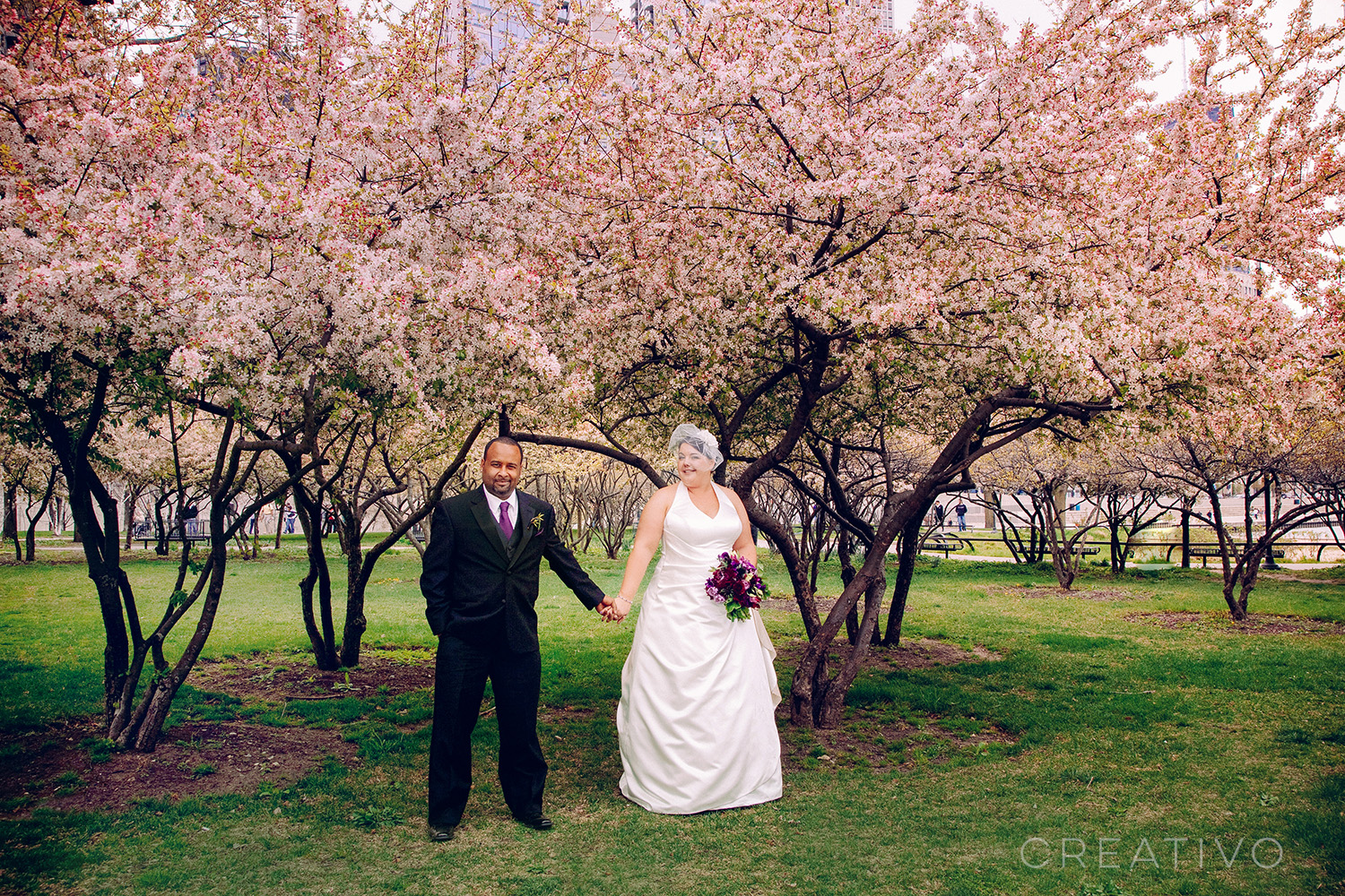 25. Spring elopement in Chicago among briefly blooming magnolia trees