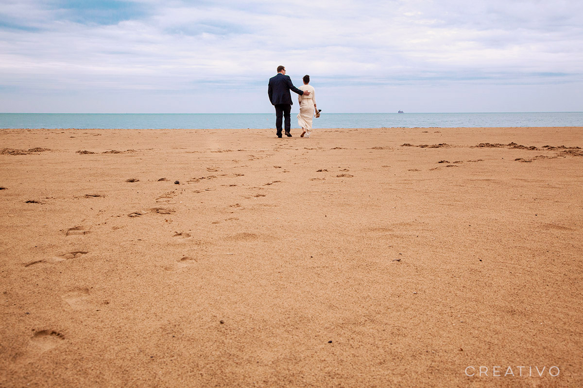 1. Beach elopement in Chicago at Lake Michigan shore. Especially during cooler shoulder seasons like spring and fall when you might even have a large area of the beach all to yourself.