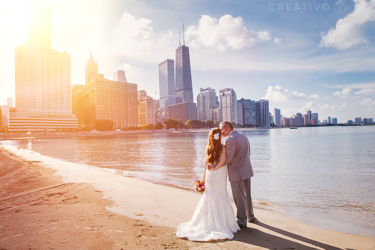 2. Beach elopement in Chicago with skyline view. Chicago's early city planners smartly designated the city's entire lake shore public property for all to enjoy.