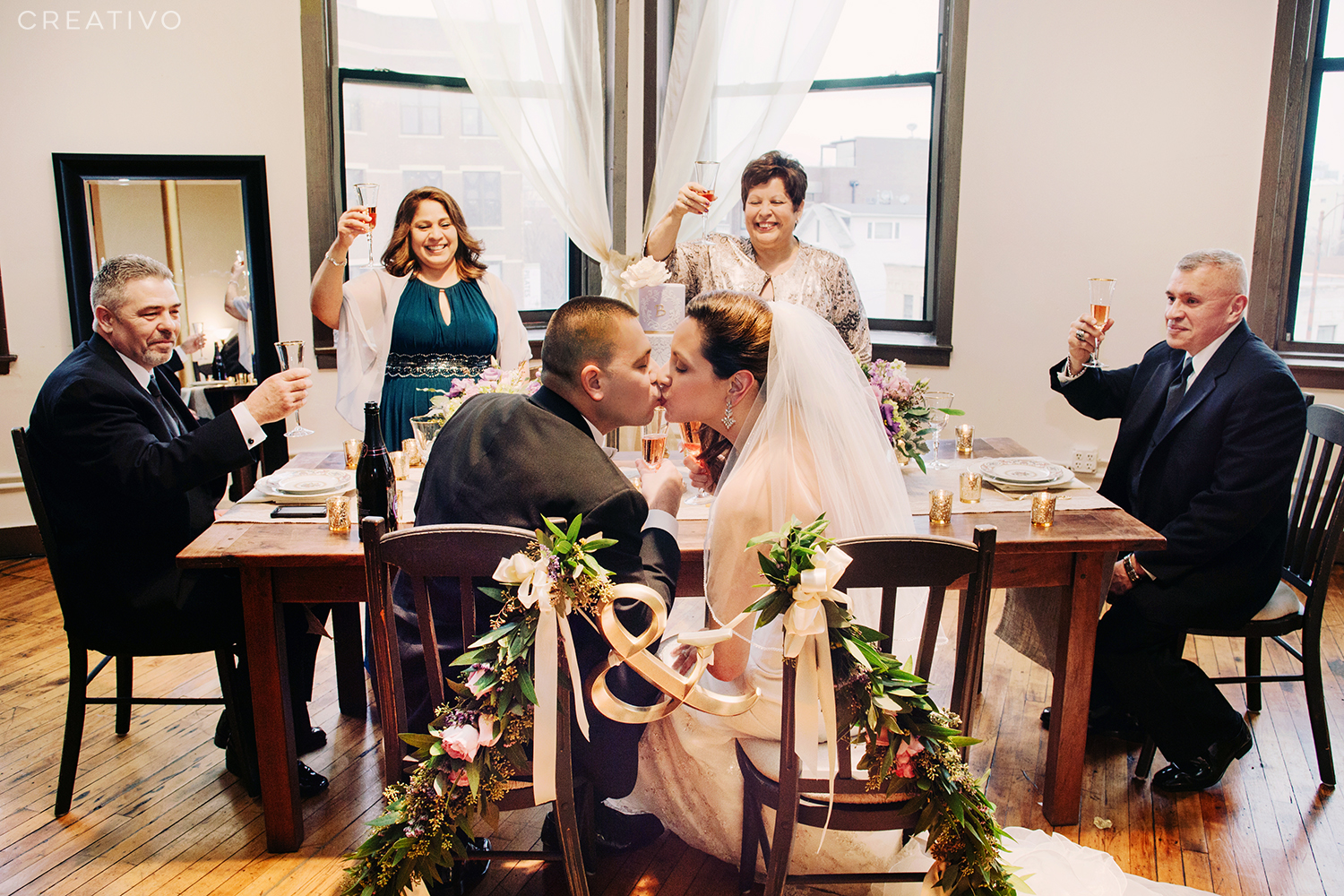 """12. A """"mini wedding"""" elopement with your parents plus custom decorations, cake and champagne"""