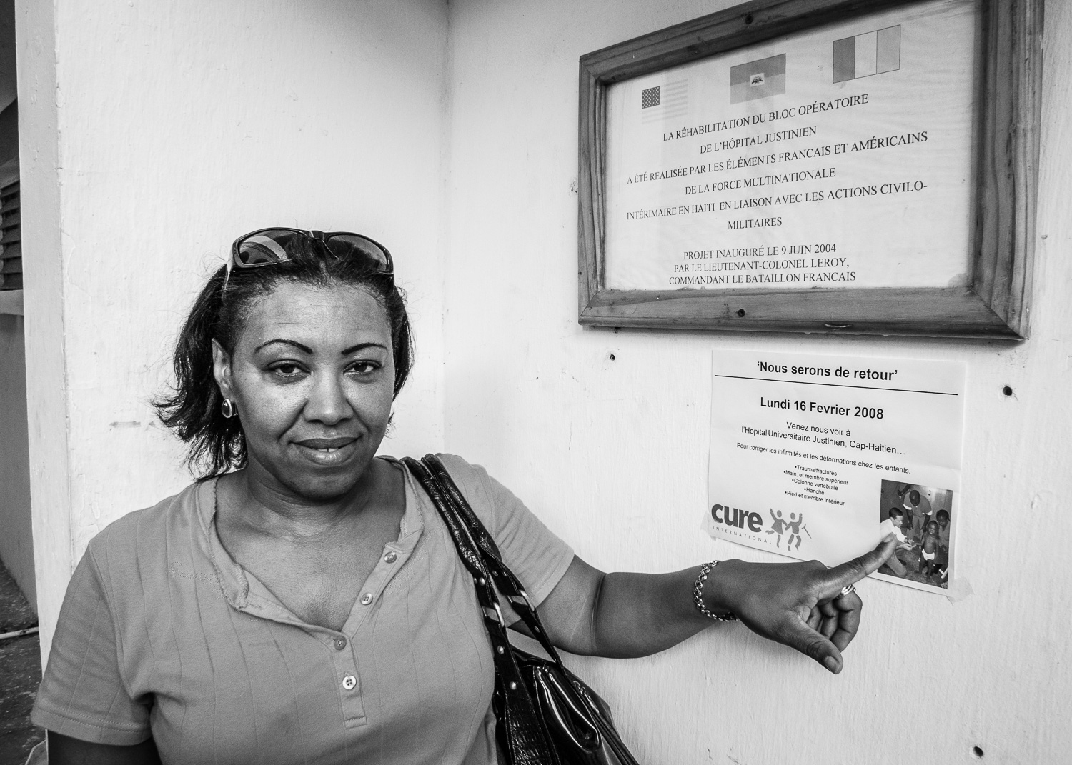 Nurse extraordinaire, Lucia from the DR, points to a sign advertising the arrival of the team.