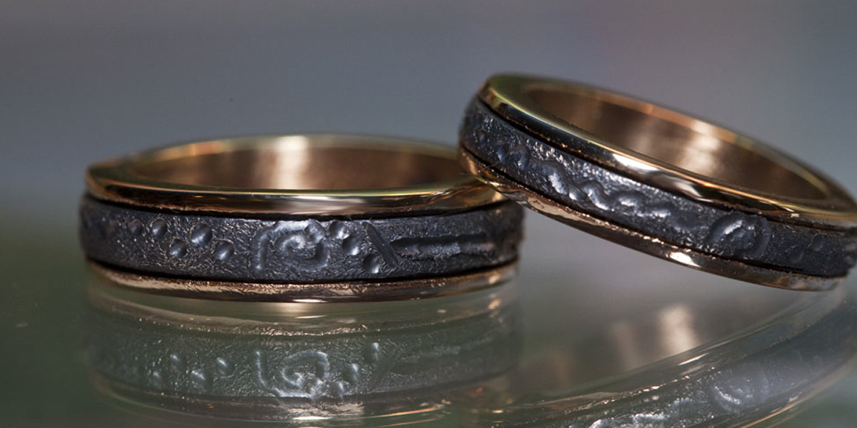 18k with Sterling Inlay Wedding RIngs Neo Nordic carvings.jpg