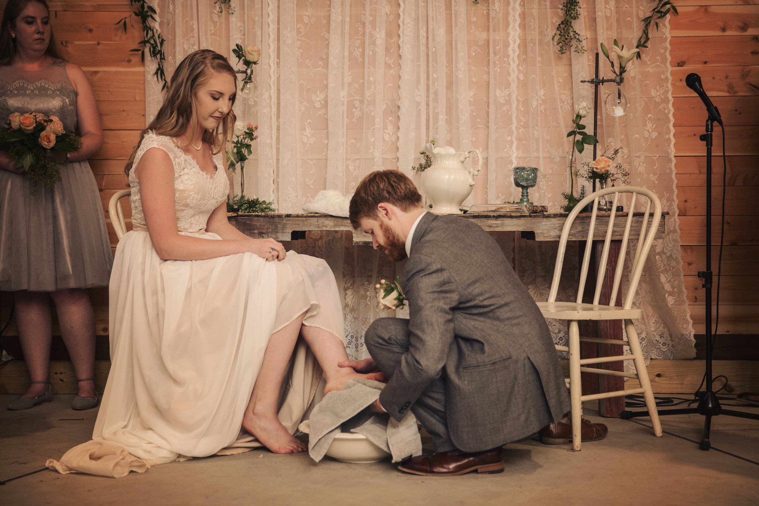 Spencer showed servanthood to his bride by washing her feet.