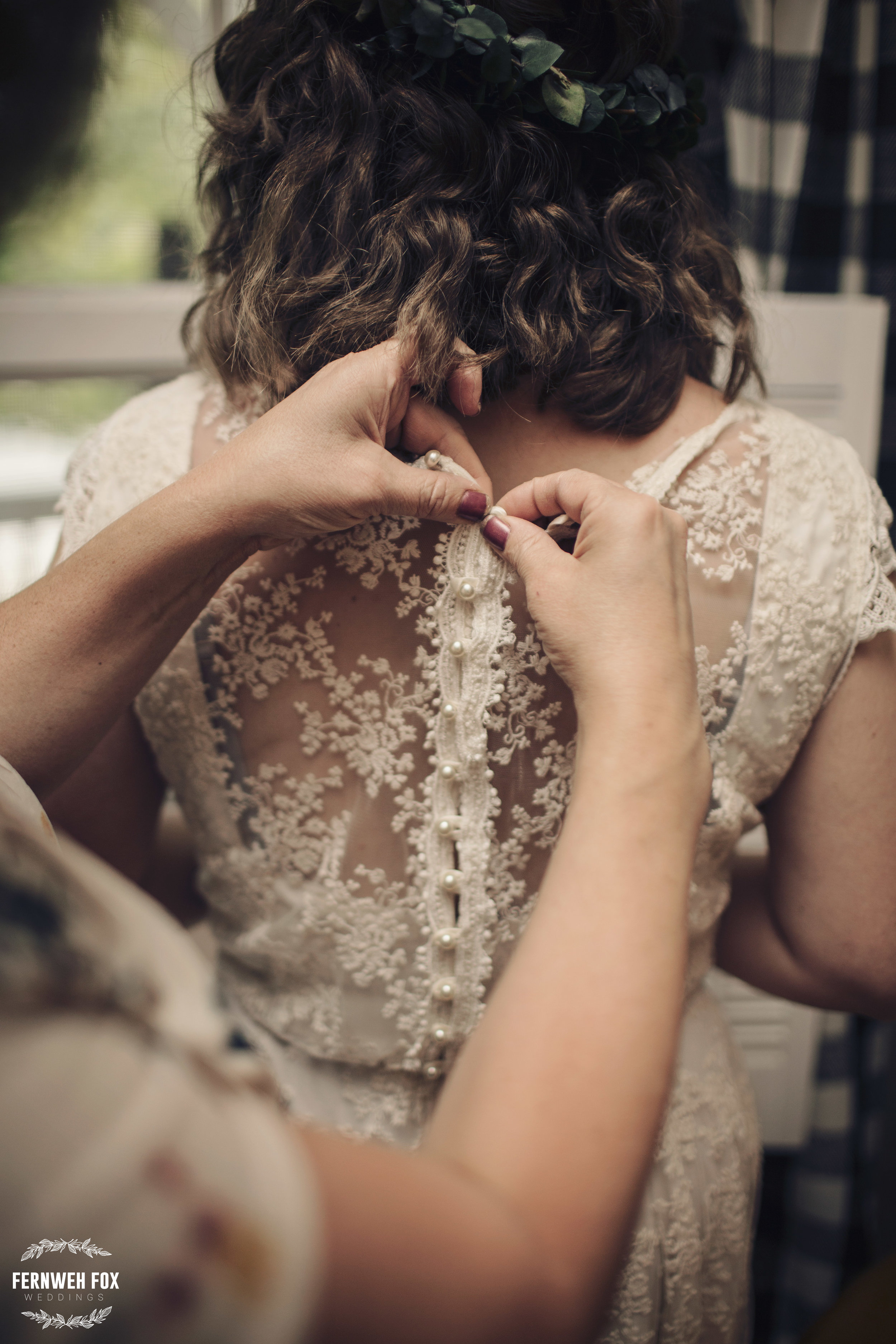 The powerful, long-awaited moment of a mother finally dressing her daughter on her wedding day. Julie built this dress for her daughter's wedding day. I can't think of a more treasured gift.