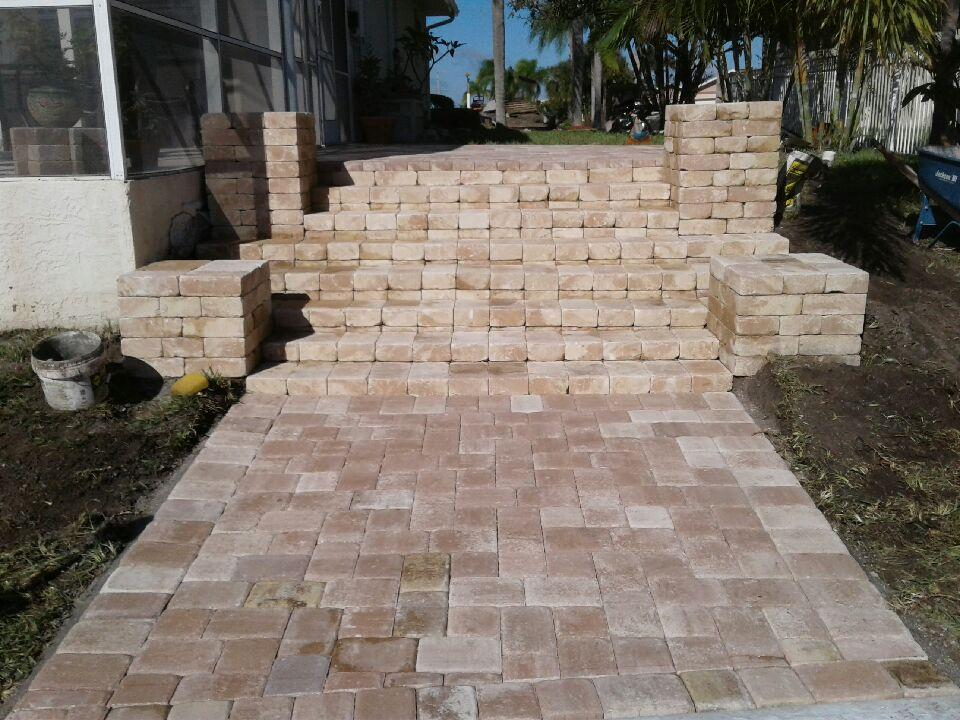 Replace your worn wood deck with an upgrade. (Appian cobble pavers in Amaretto blend)