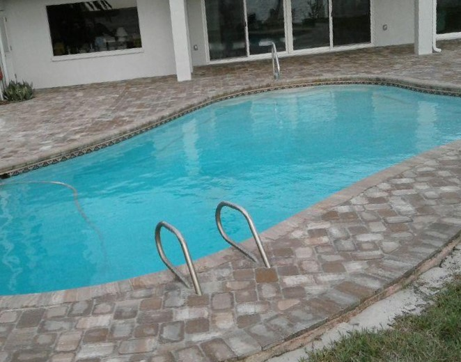 Adding pavers gave this pool deck new life. (Appian cobble in Napoli blend)