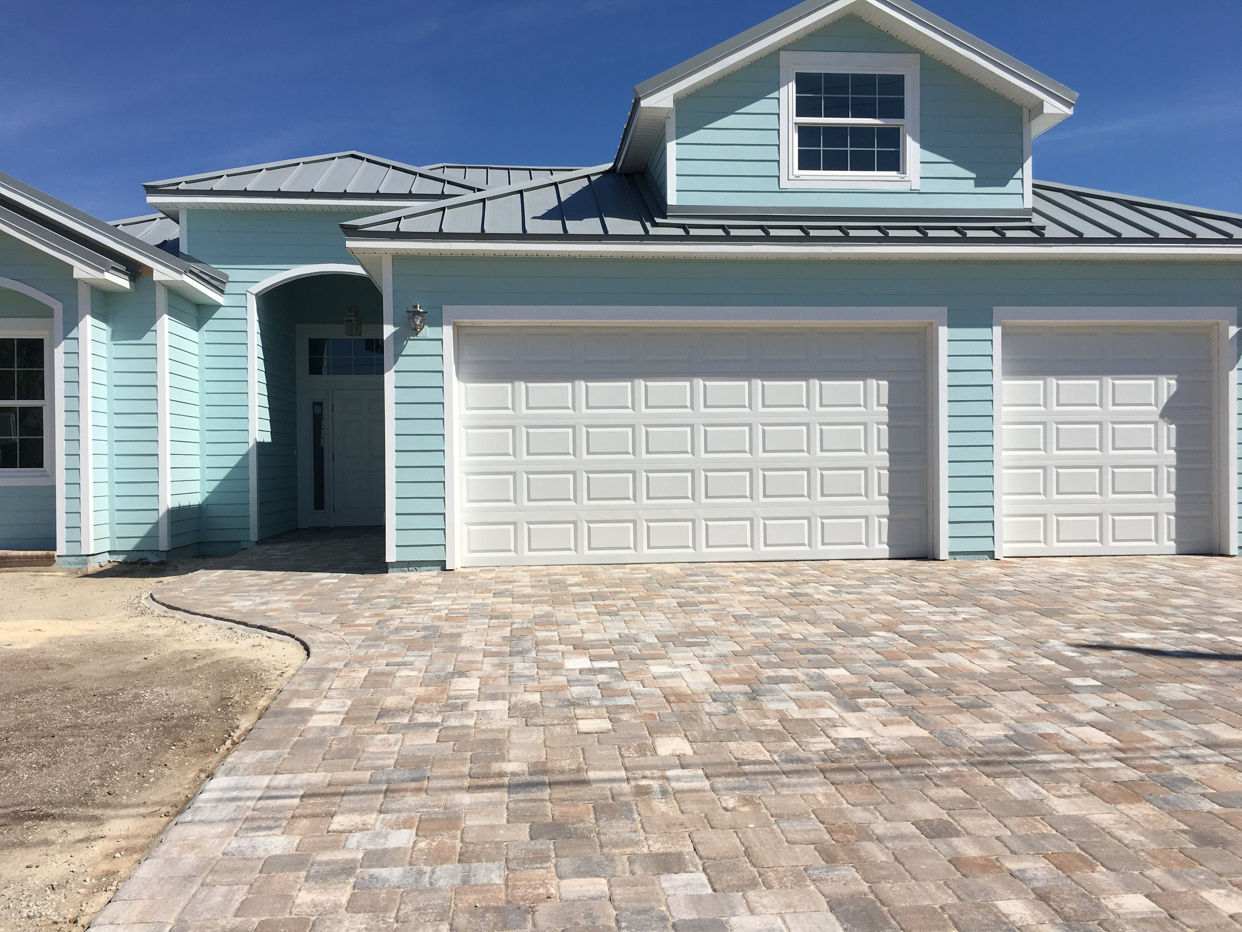 Adding a paver driveway will add to your home's value as well as its curb appeal.