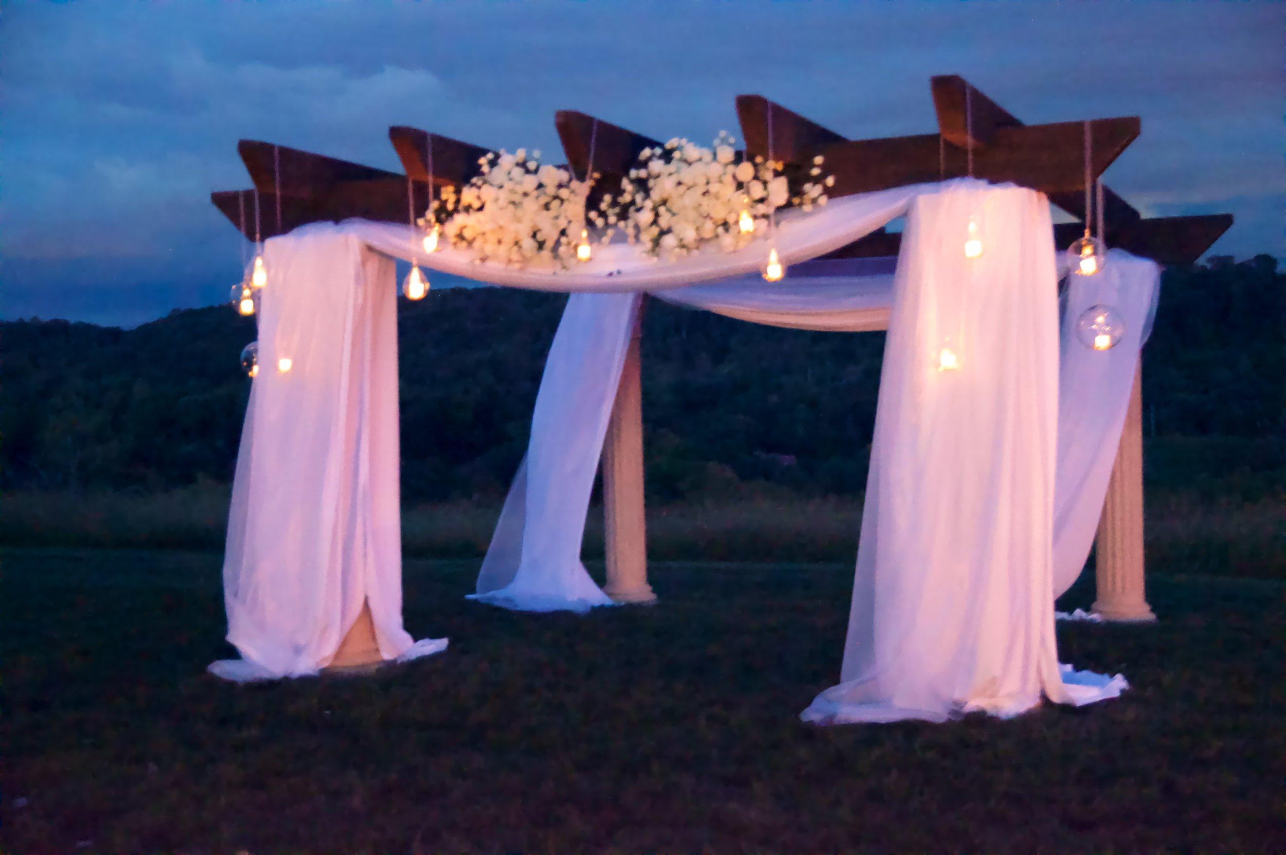wedding arbor draped in soft lght