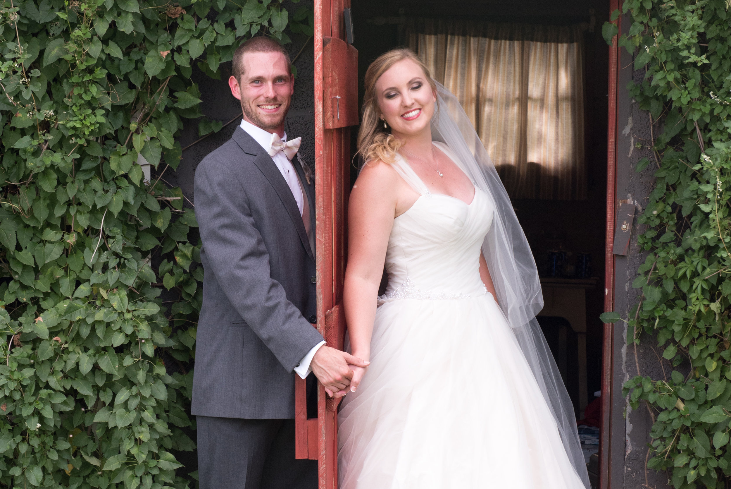 First Look with a door between them. The groom did not want to see his bride before the wedding. But just holding hands and hearing one another's voice can be calming.
