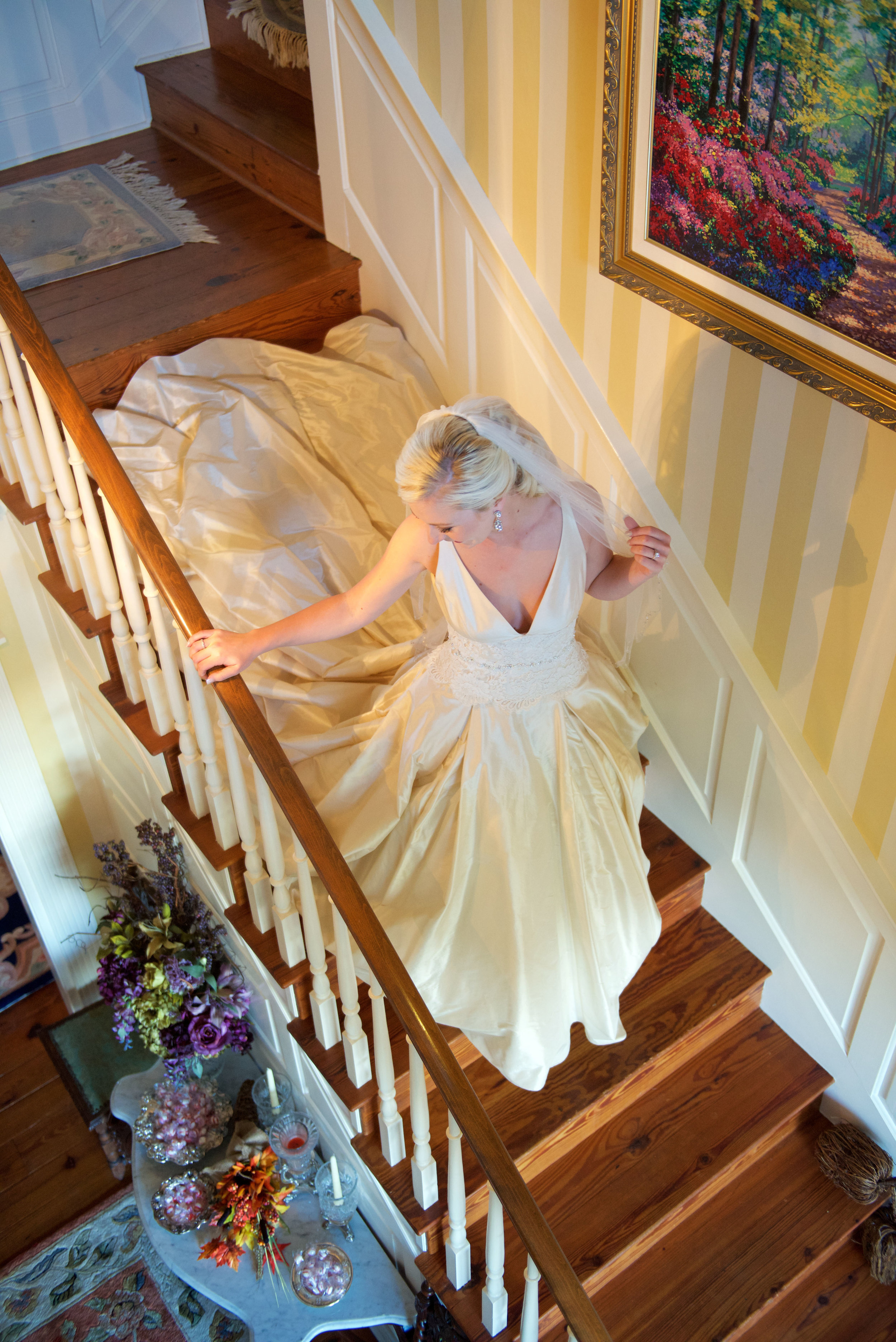 Bride cascades down a staircase in her wedding gown