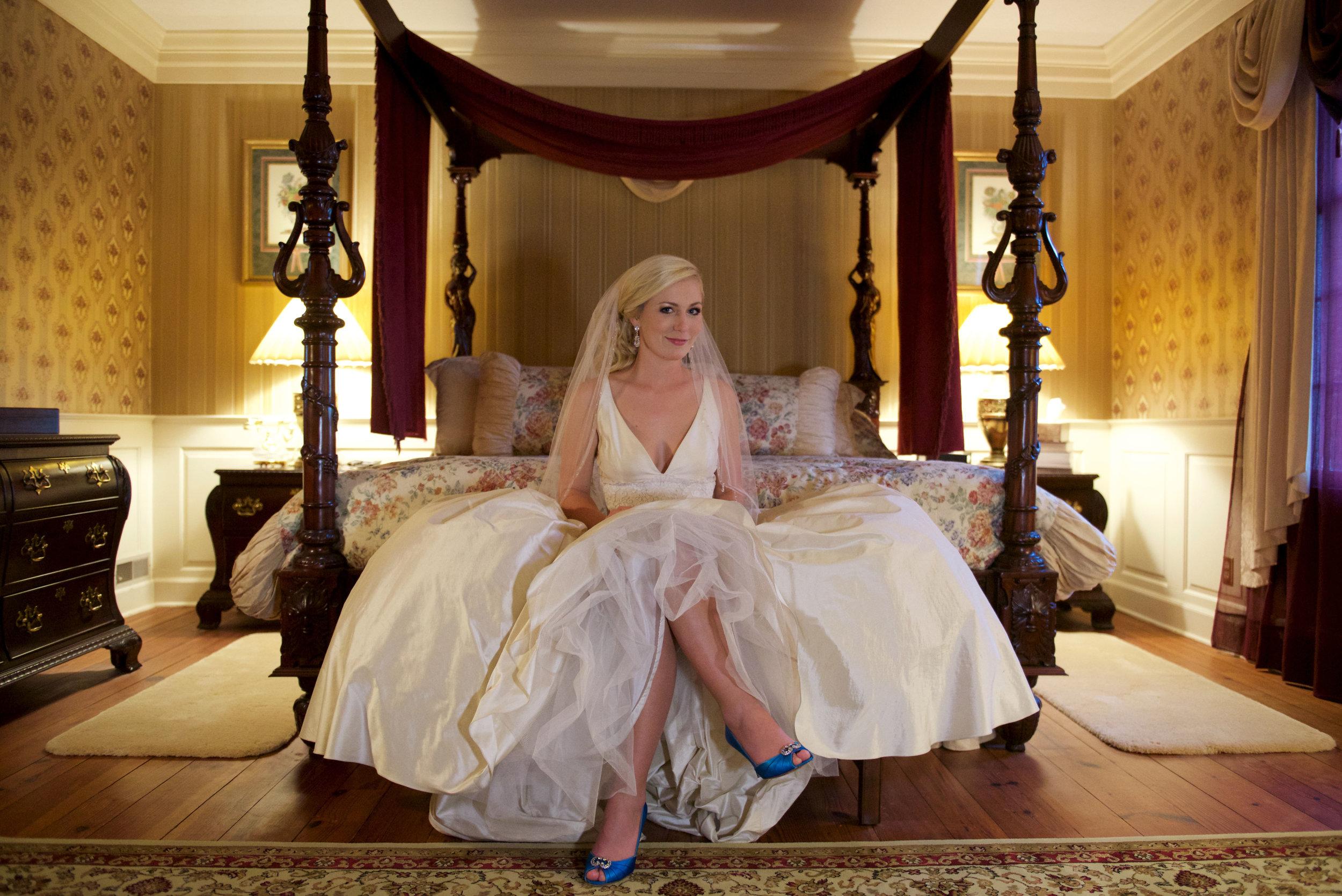 Bride showing off blue shoes
