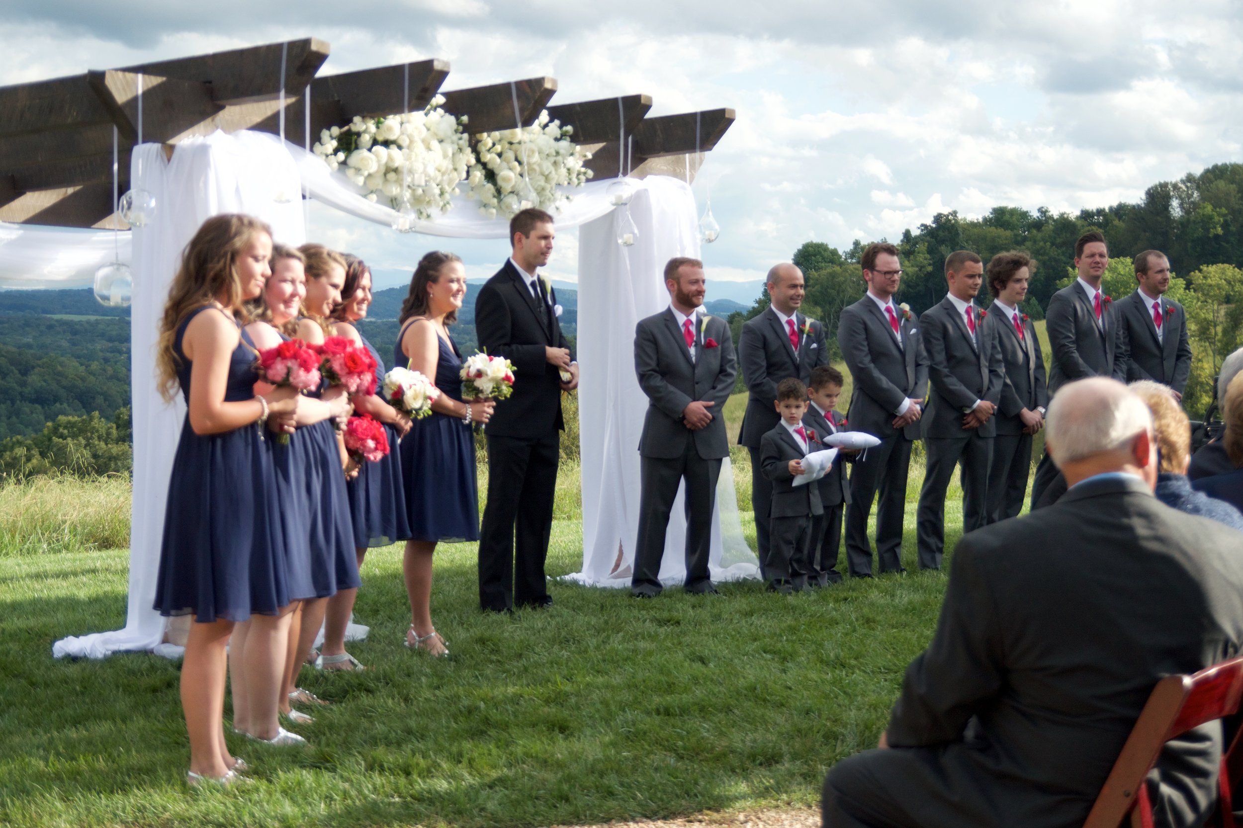 Getting the bridesmaids and groomsmen perfectly placed takes work too.