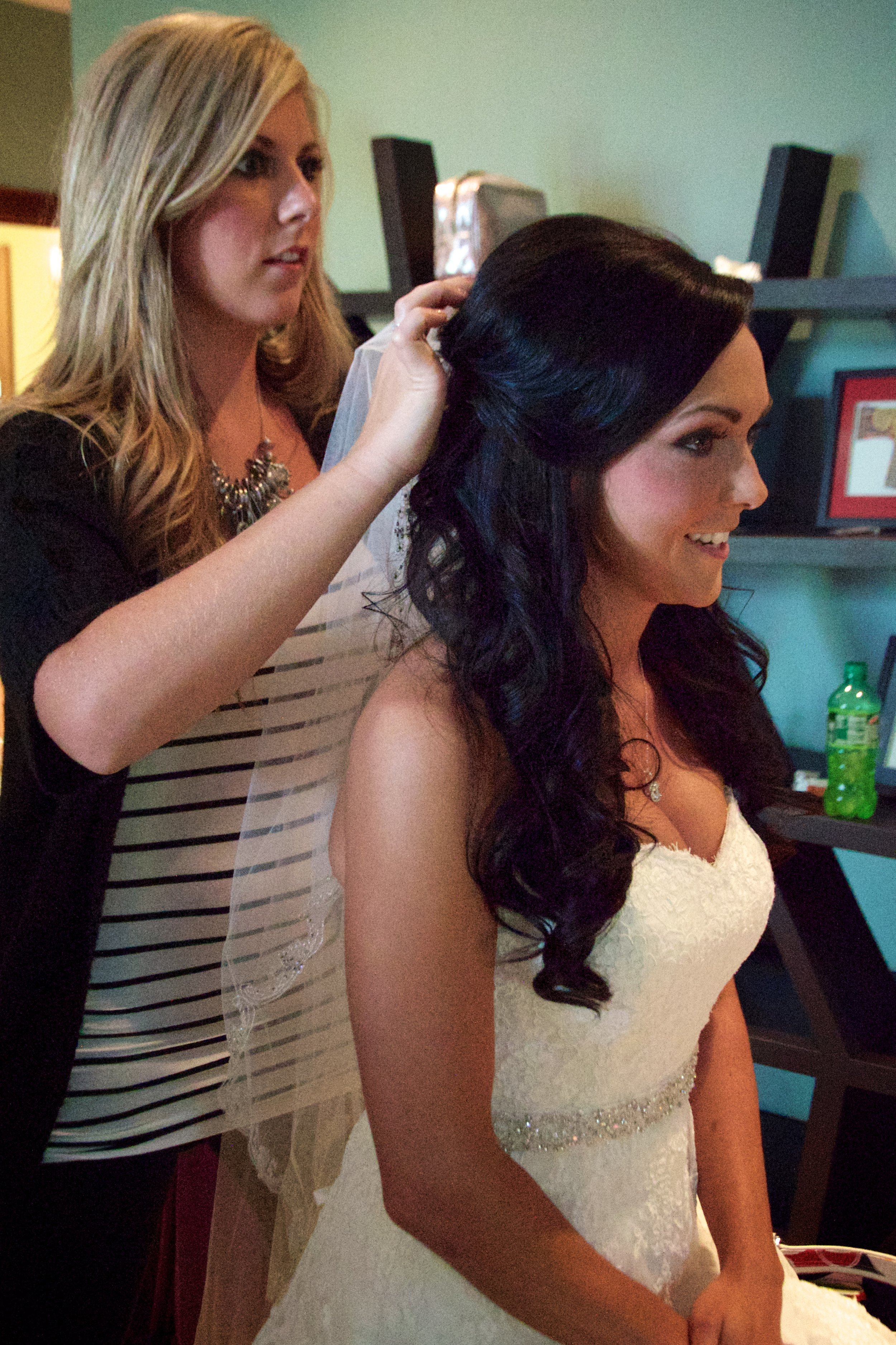 Bride having her hair fixed perfectly