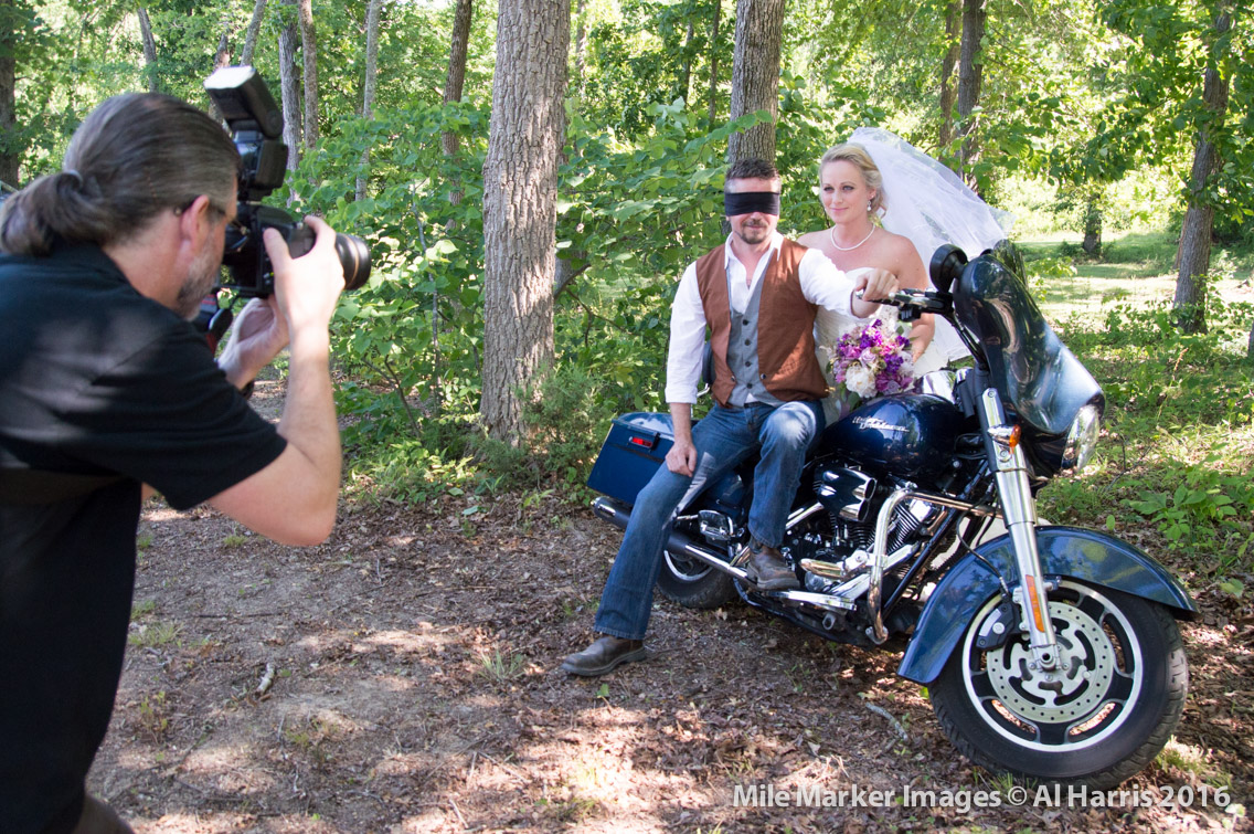 bride and groom on a Harley during first look