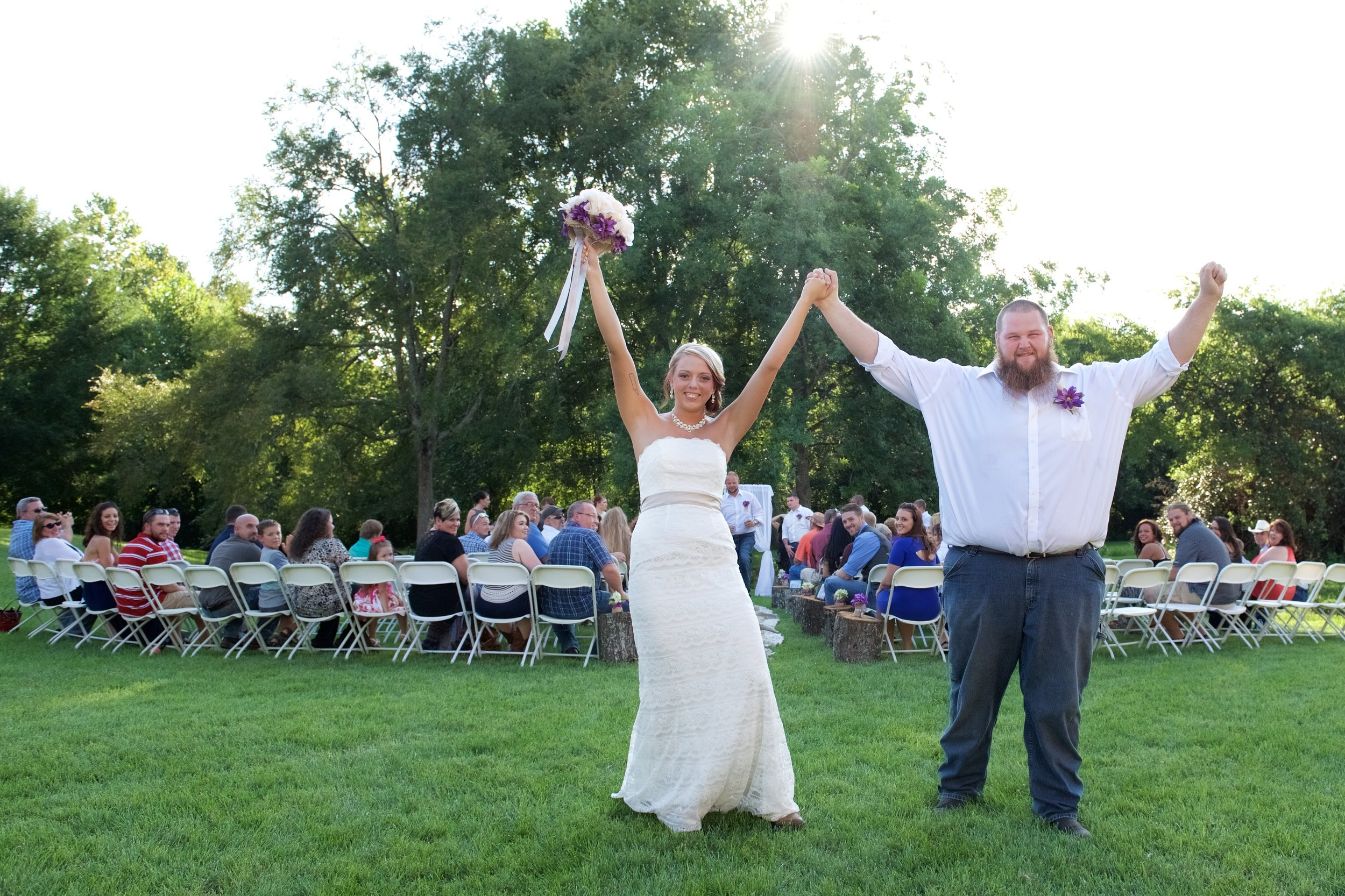 I love the sun peaking over the trees and how the light wraps this couple.