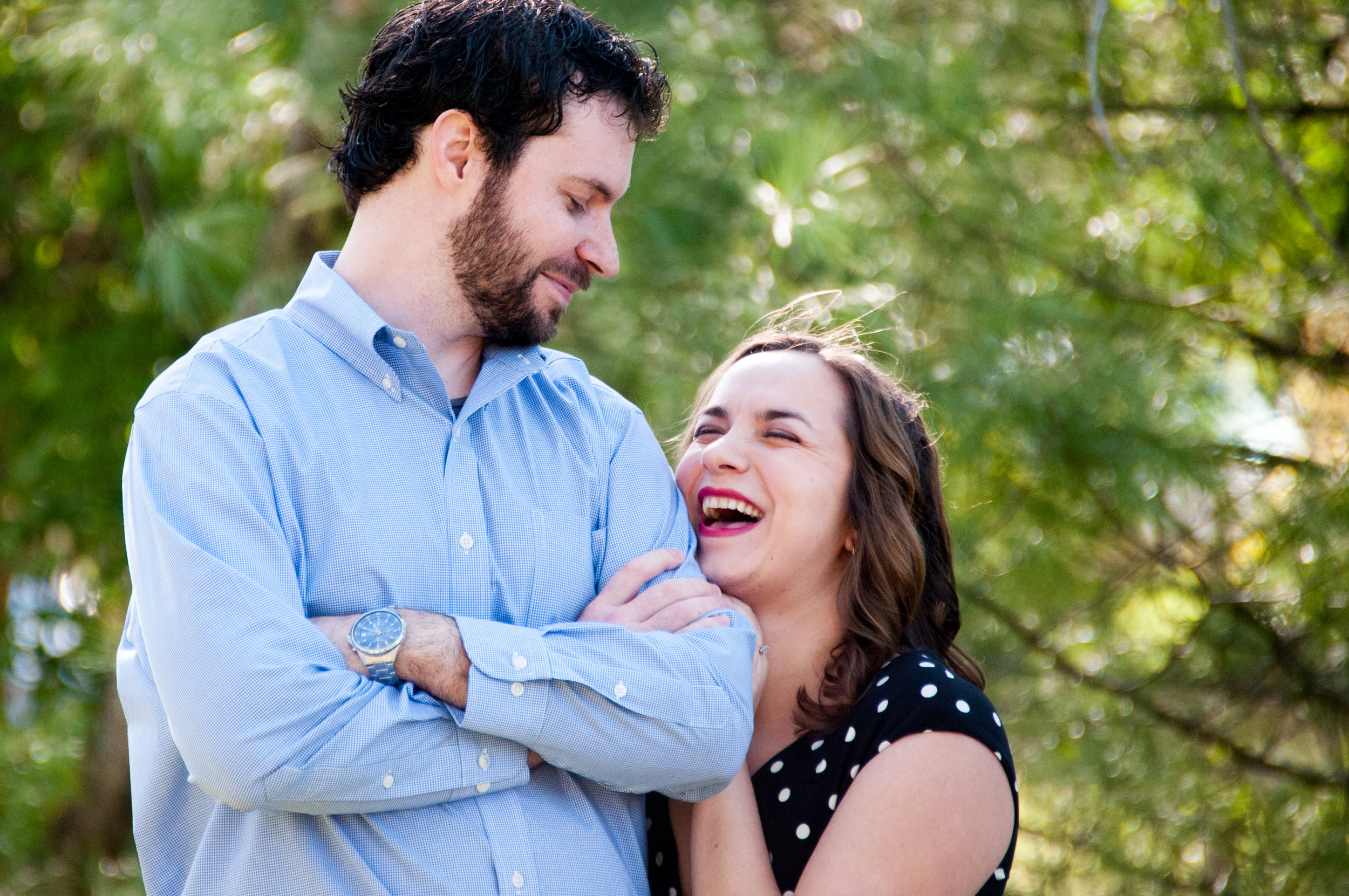 Engaged couple laughing & being silly!