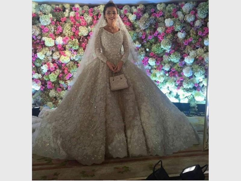 The dress is what it is - lavish, over the top & heavy too. But notice the flowers - floor to ceiling.
