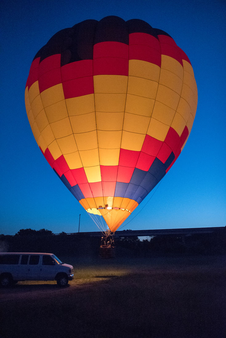 Bride & Groom in a hot air balloon lift off for engagement photo flight!