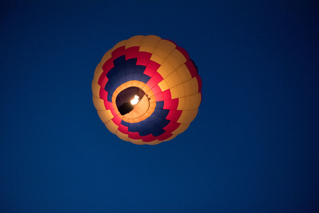 Bride & Groom in a hot air balloon lift off into cobalt blue skies!