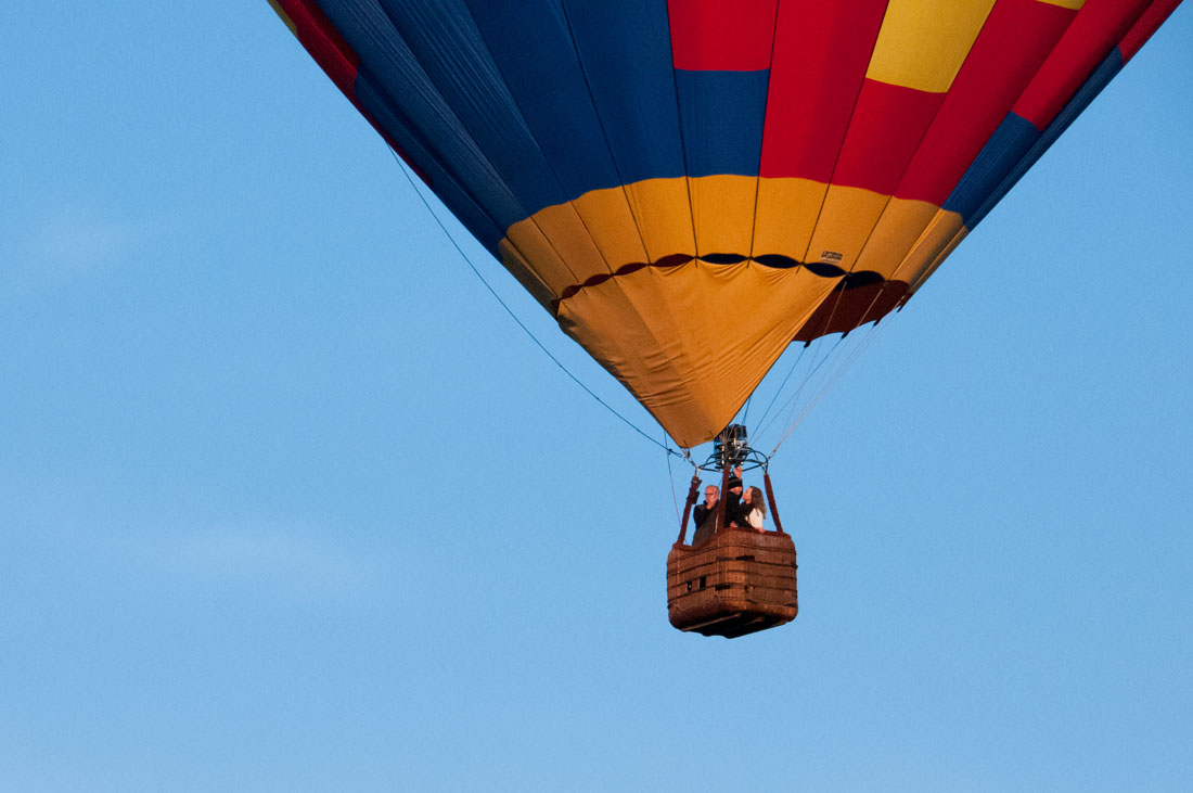 Bride & Groom in blue skies in a hot air balloon.
