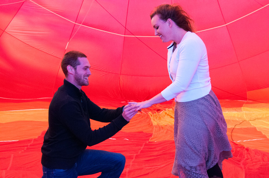 Bride & Groom on one knee inside a hot air balloon!