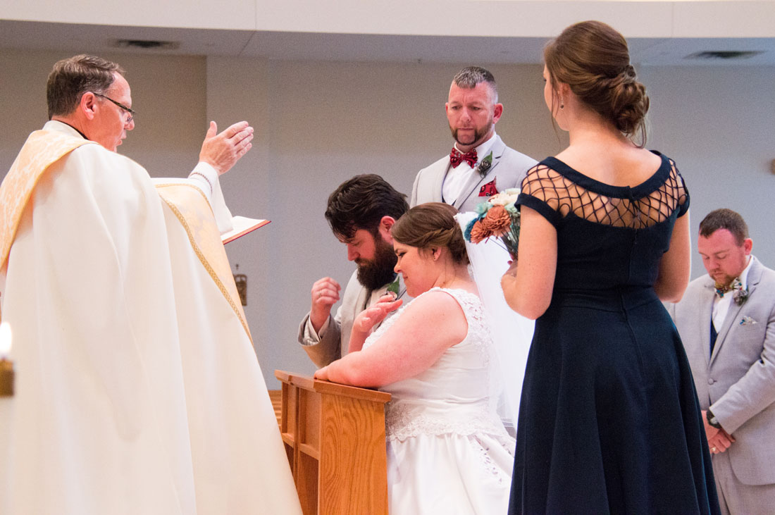 Paul & Ashley cross themselves as the Father Bill crosses them - LOVE THIS!
